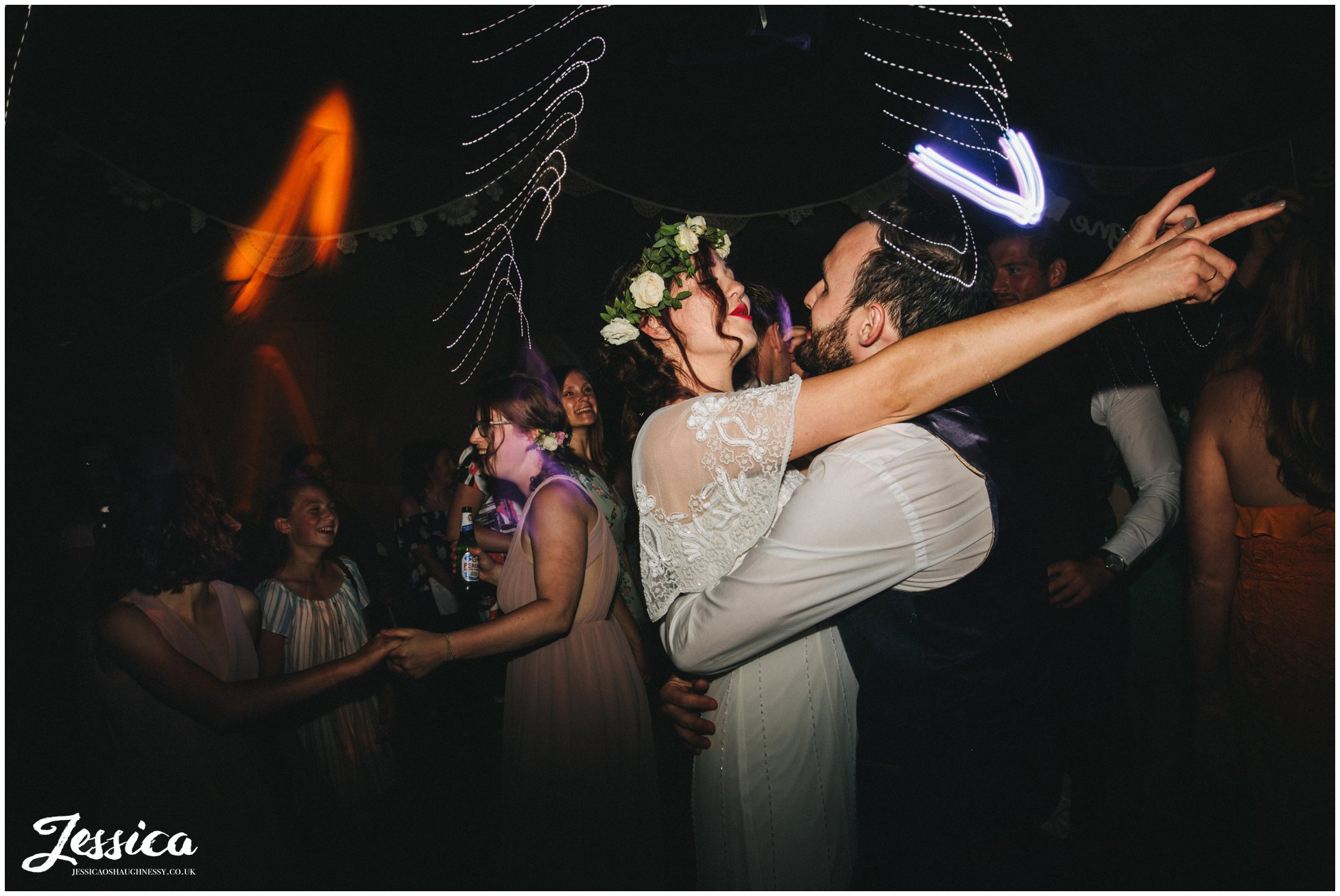 husband and wife dance together to their wedding band