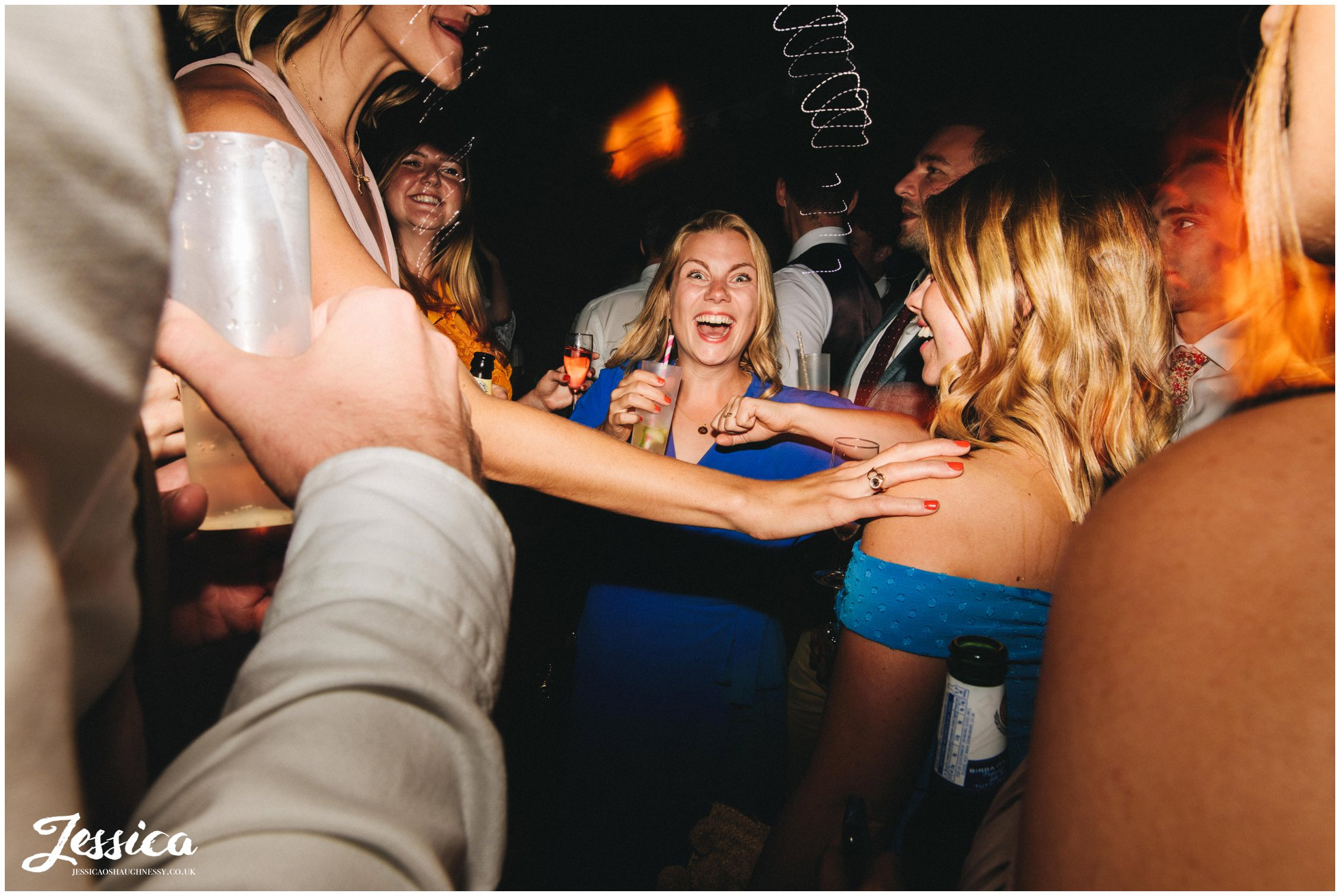 brides friends dance in the tipi wedding reception