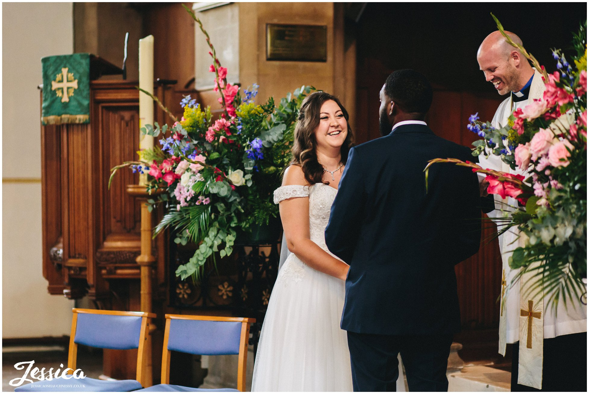 the bride laughs during their london wedding ceremony
