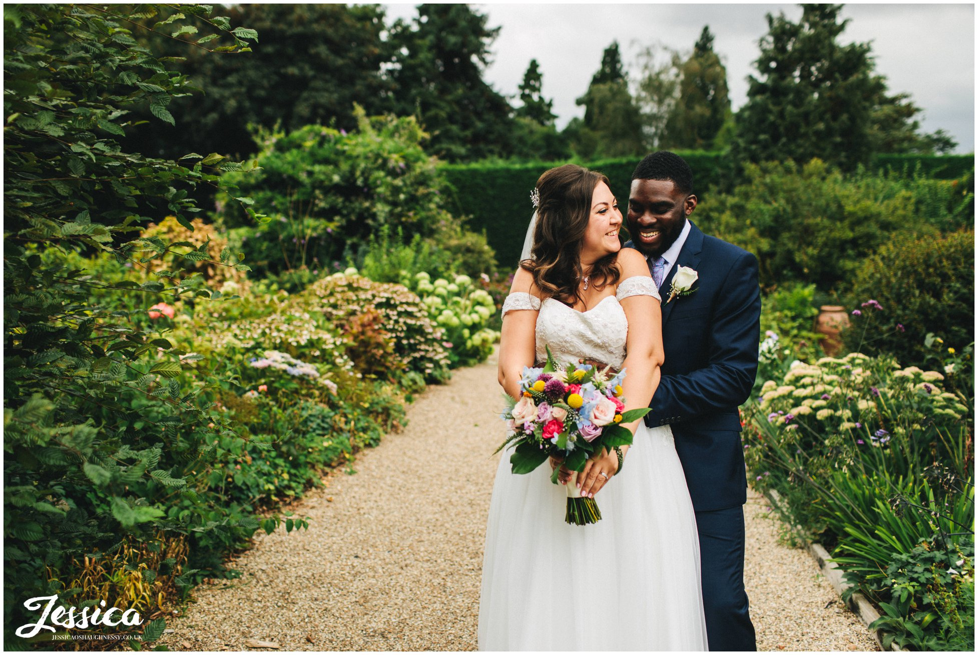 the couple laugh whilst hugging in the epping wedding venue