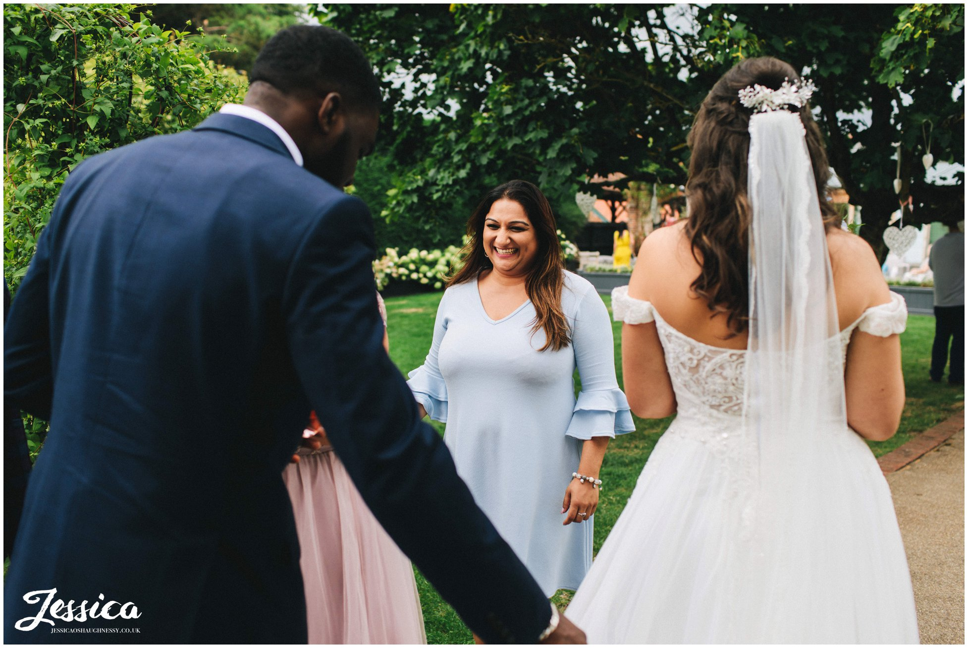 wedding guests speak to the couple during their drinks reception