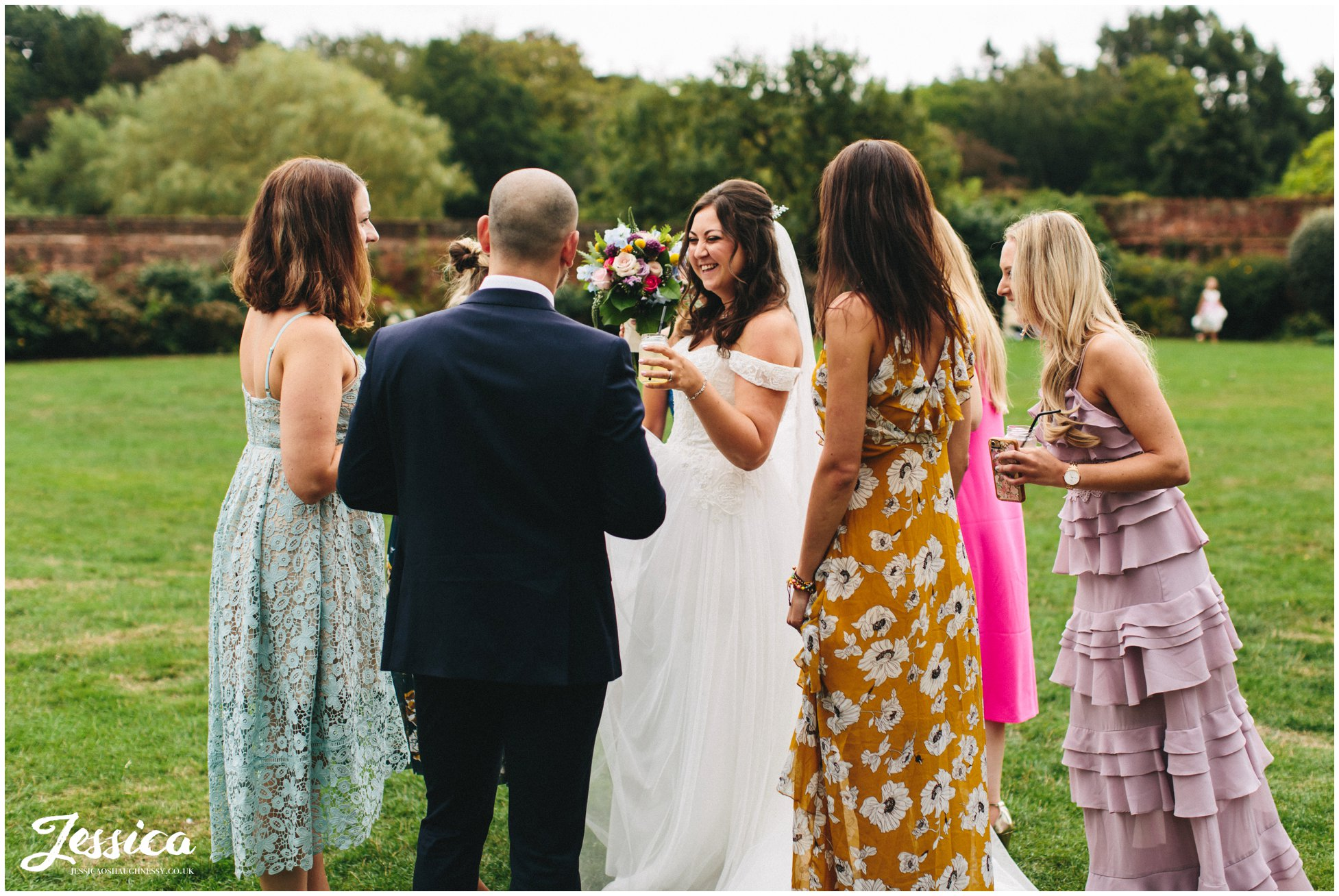 the bride laughs with her friends
