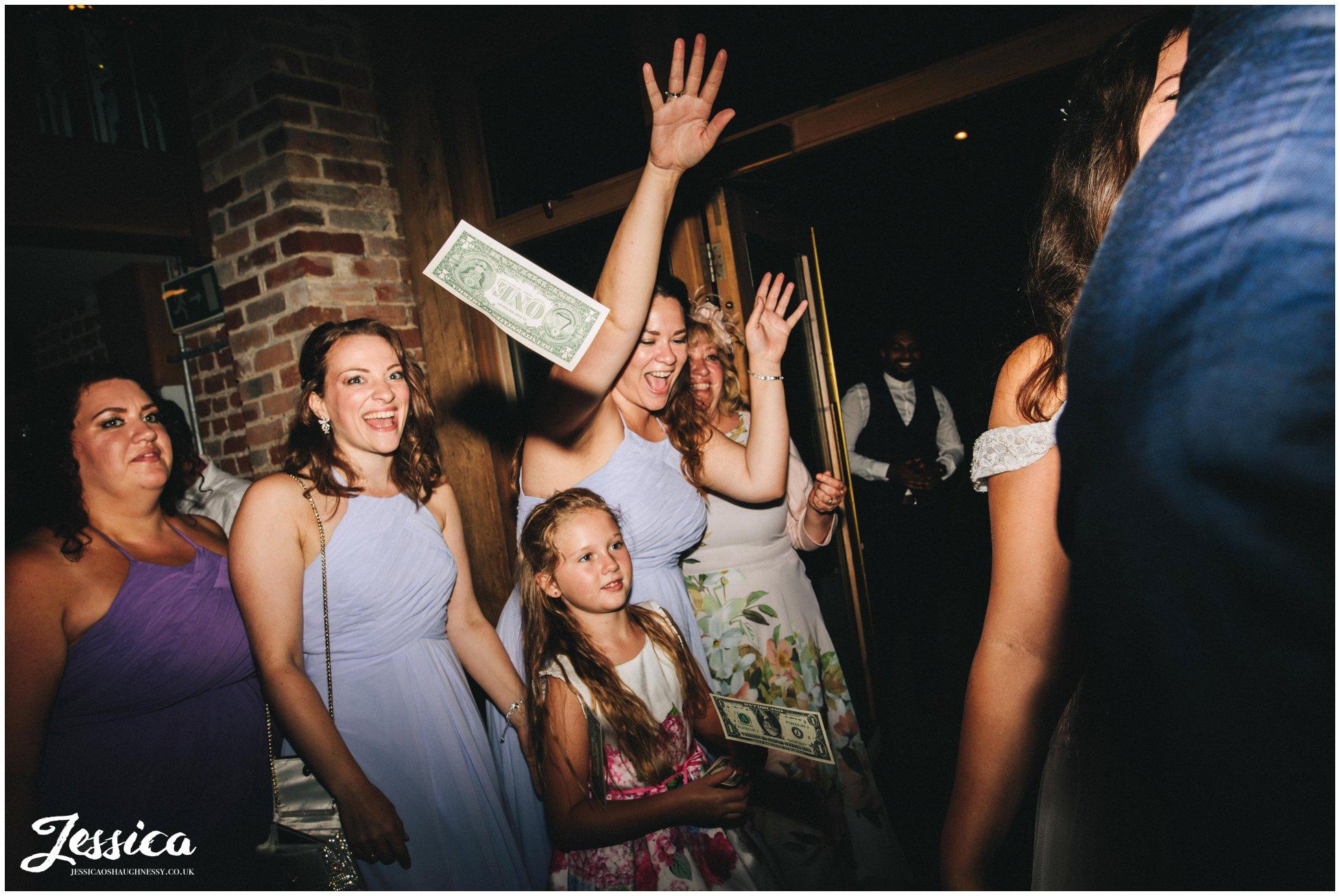 the bridesmaids throw dollars at gaynes park