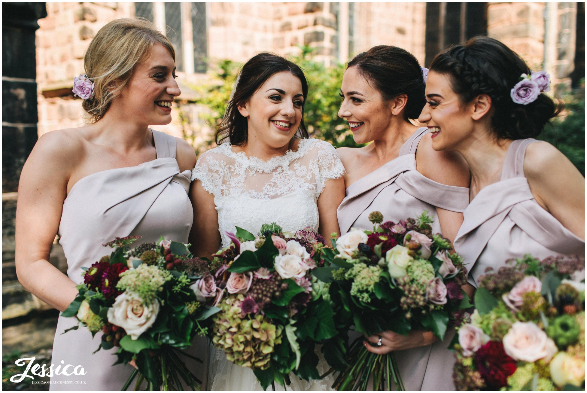 bride and bridesmaids laugh together before the ceremony