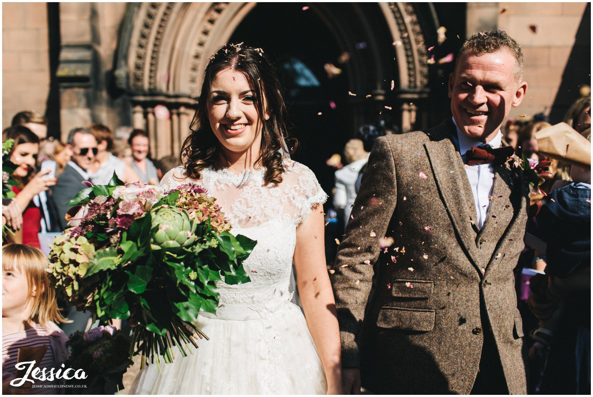 guests shower the couple with confetti at st mary's in nantwich