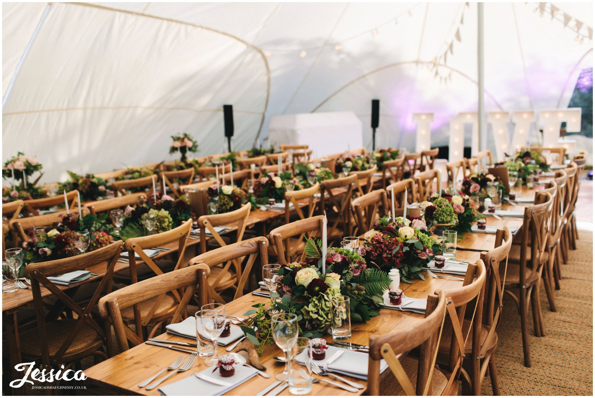 flowers decorate the marquee at a diy cheshire wedding