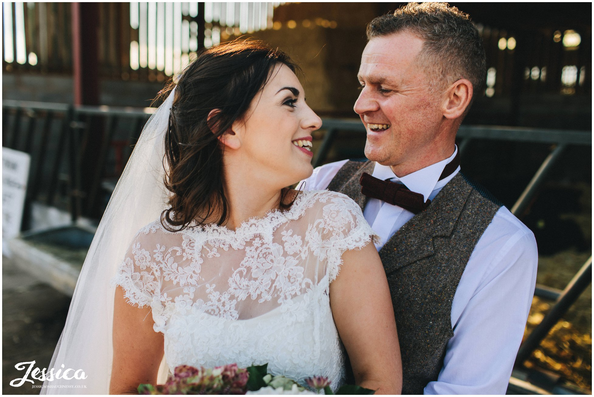 couple laugh together on their nantwich wedding day