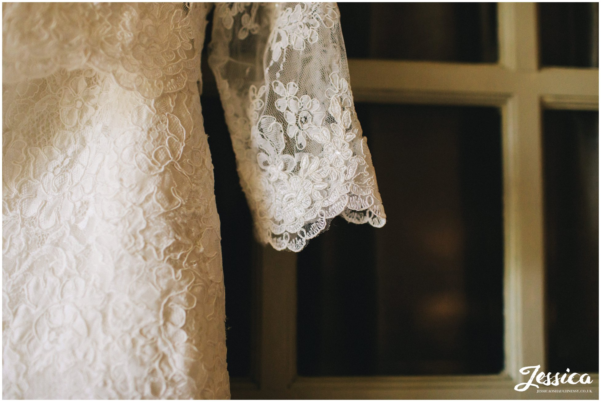 detail shot the of lace of the brides wedding dress