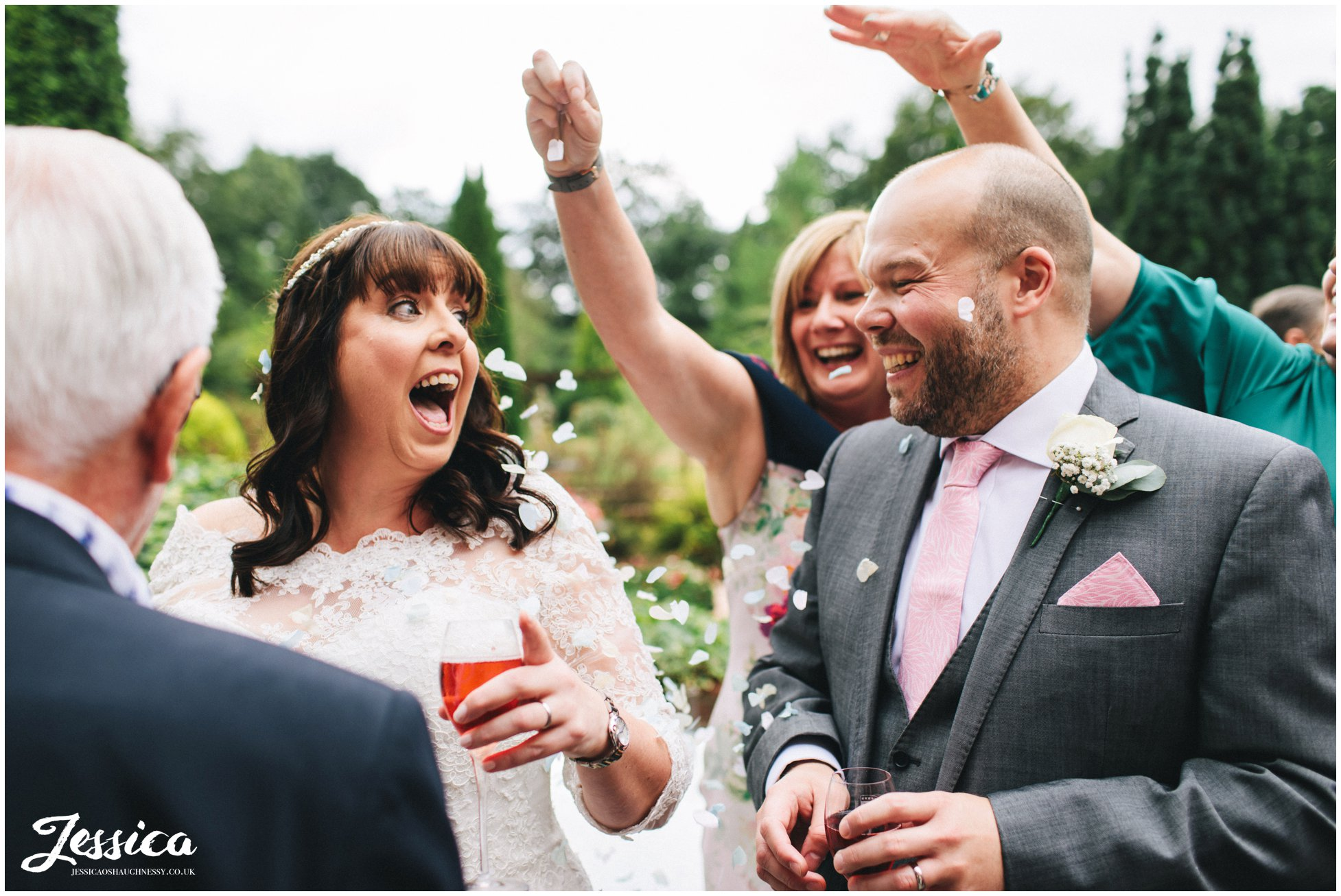 guests surprise the couple by showering them in confetti