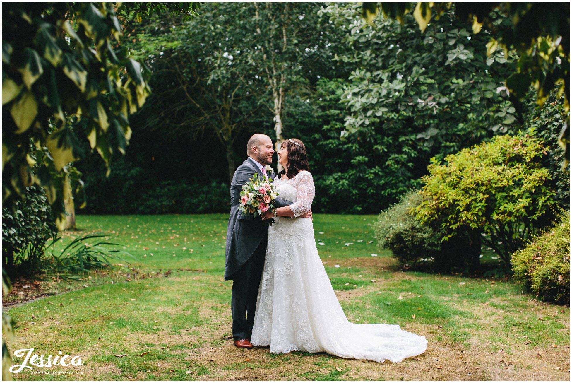 the newly wed's kiss in the gardens at nunsmere hall