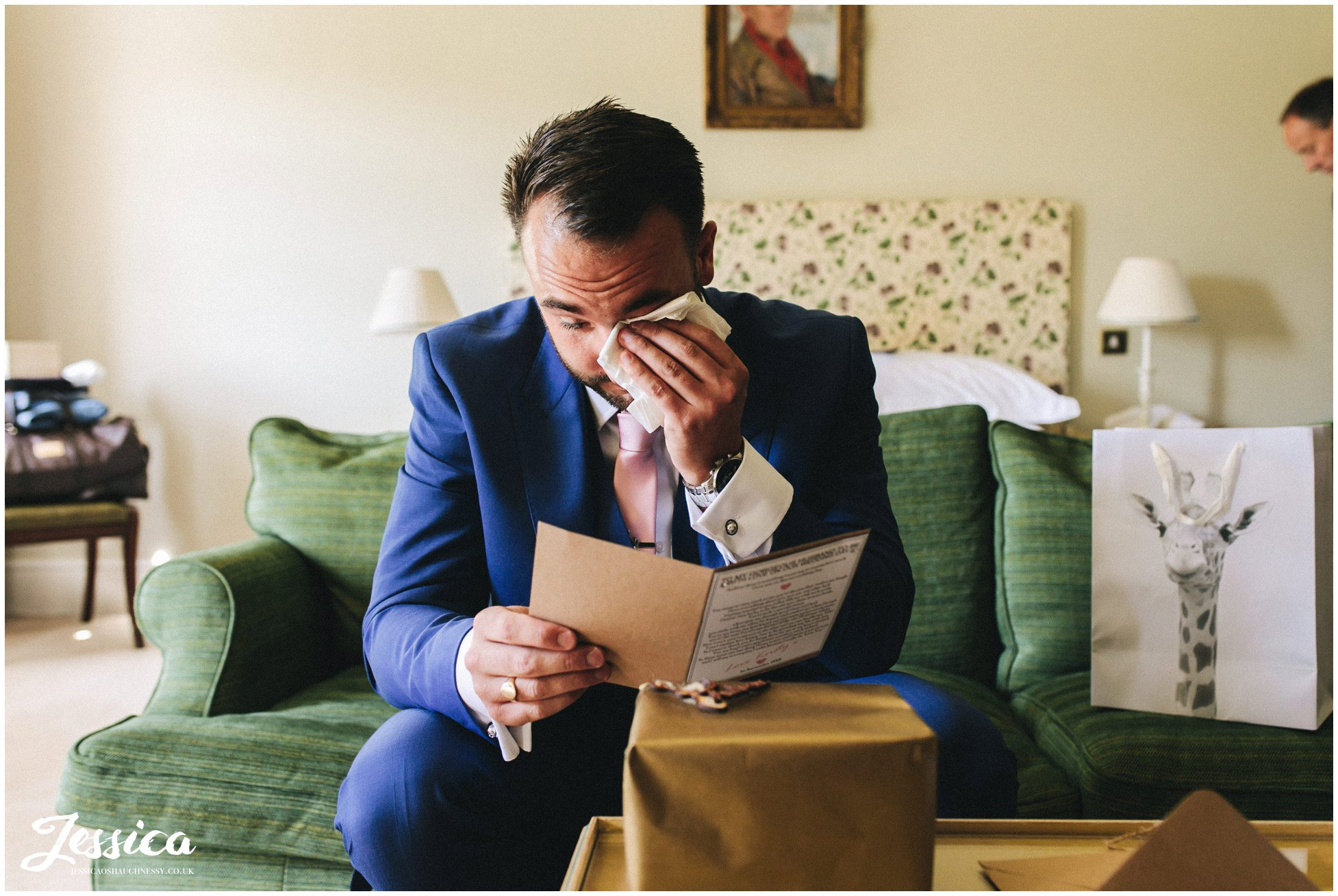 the groom cries as he reads a note from the bride