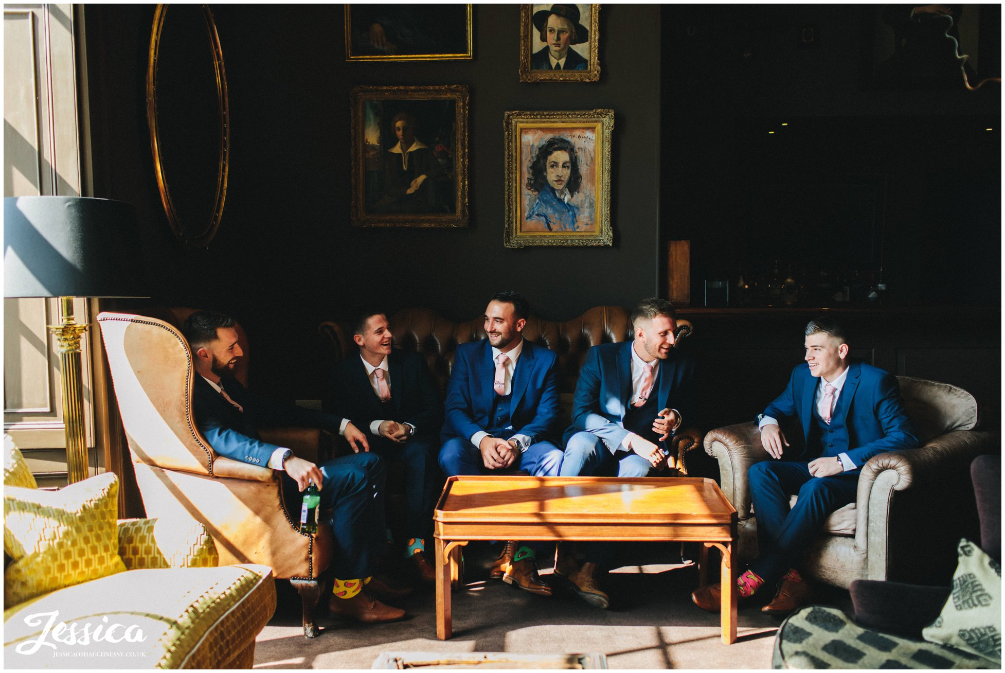 the groomsmen gather in the chocolate room at stubton hall