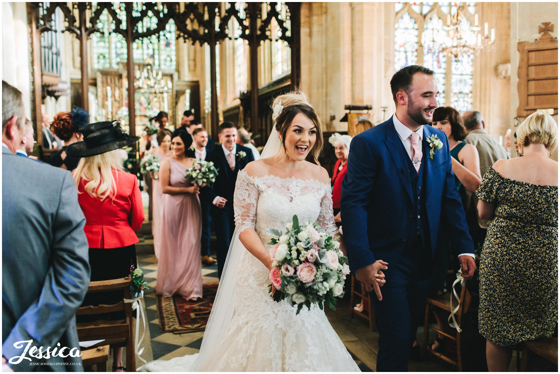 the couple walk back down the aisle as husband and wife
