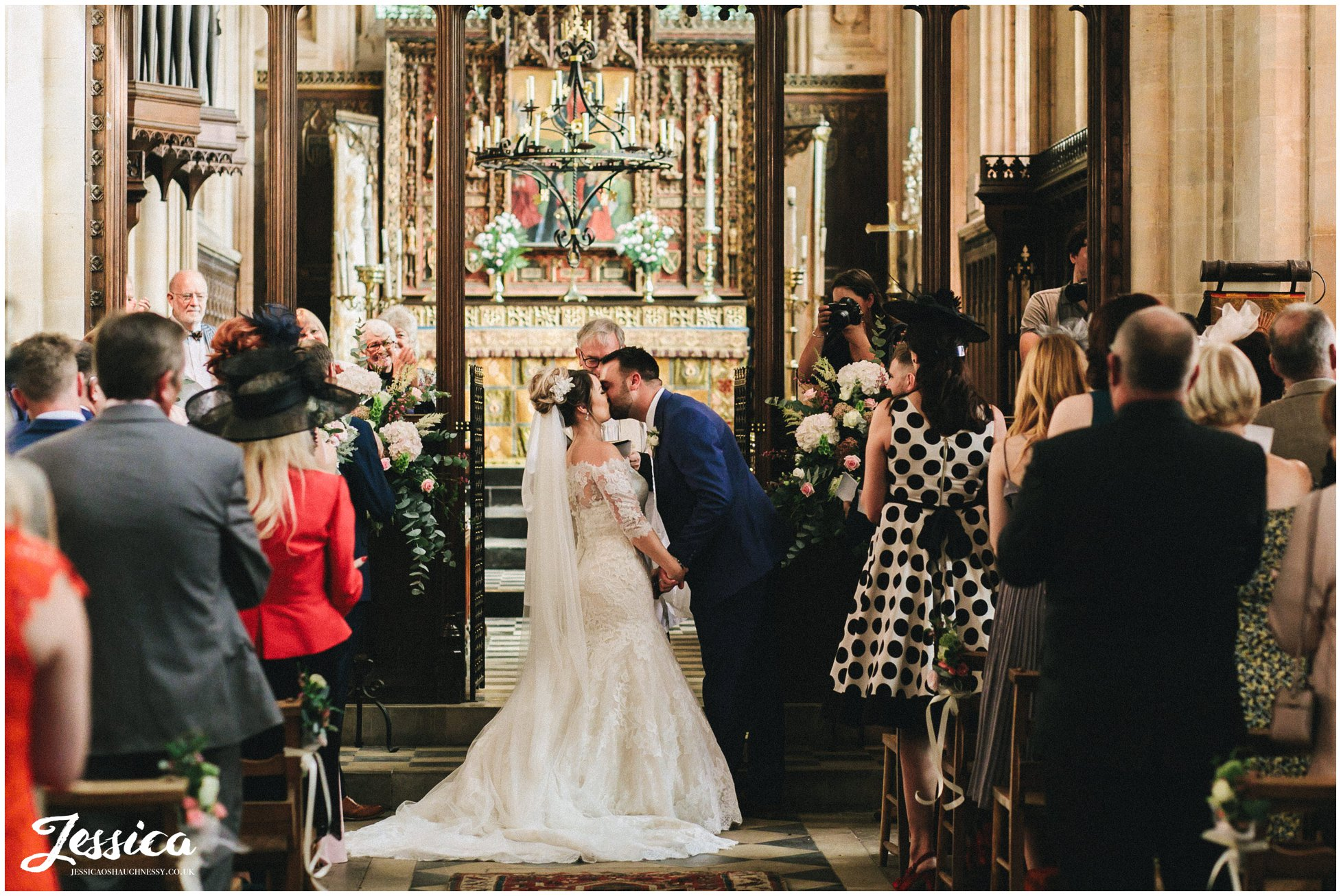 the couple share their first kiss as husband and wife