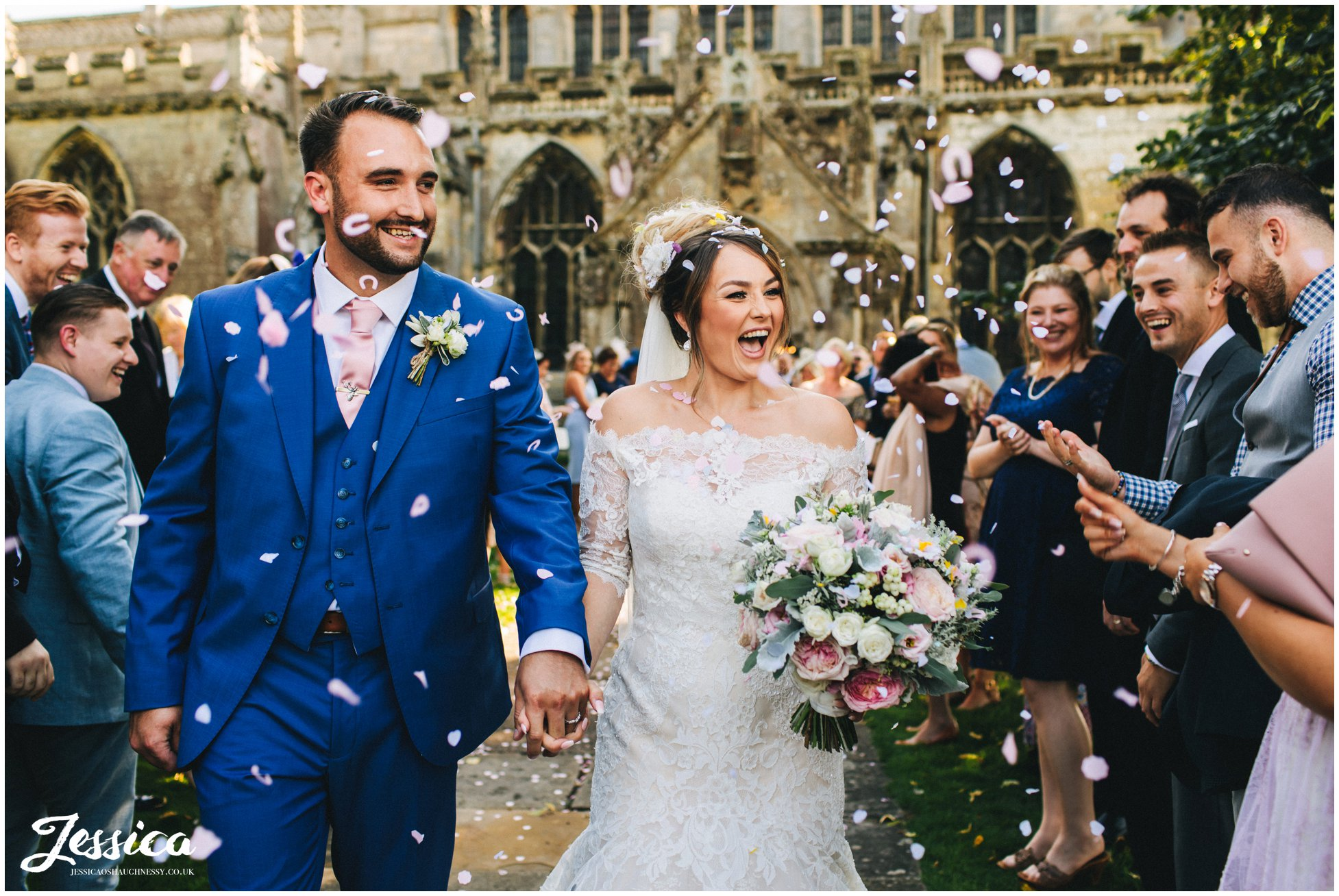 the couple are showered with confetti by their friends and family