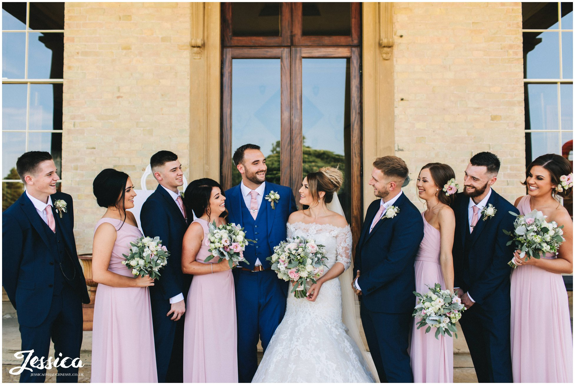 the whole wedding party laugh together