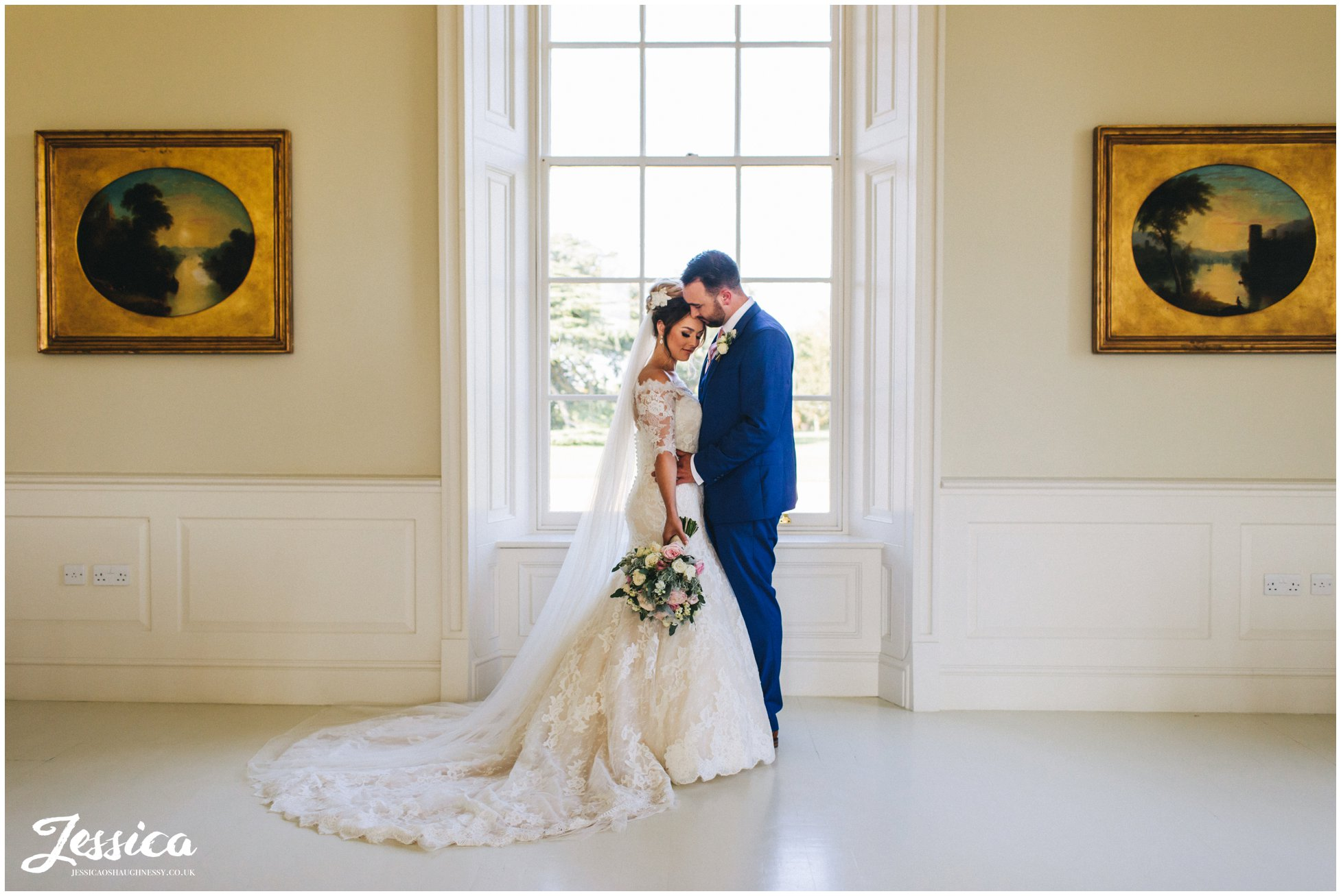 the couple hold each other in stubton hall's music room
