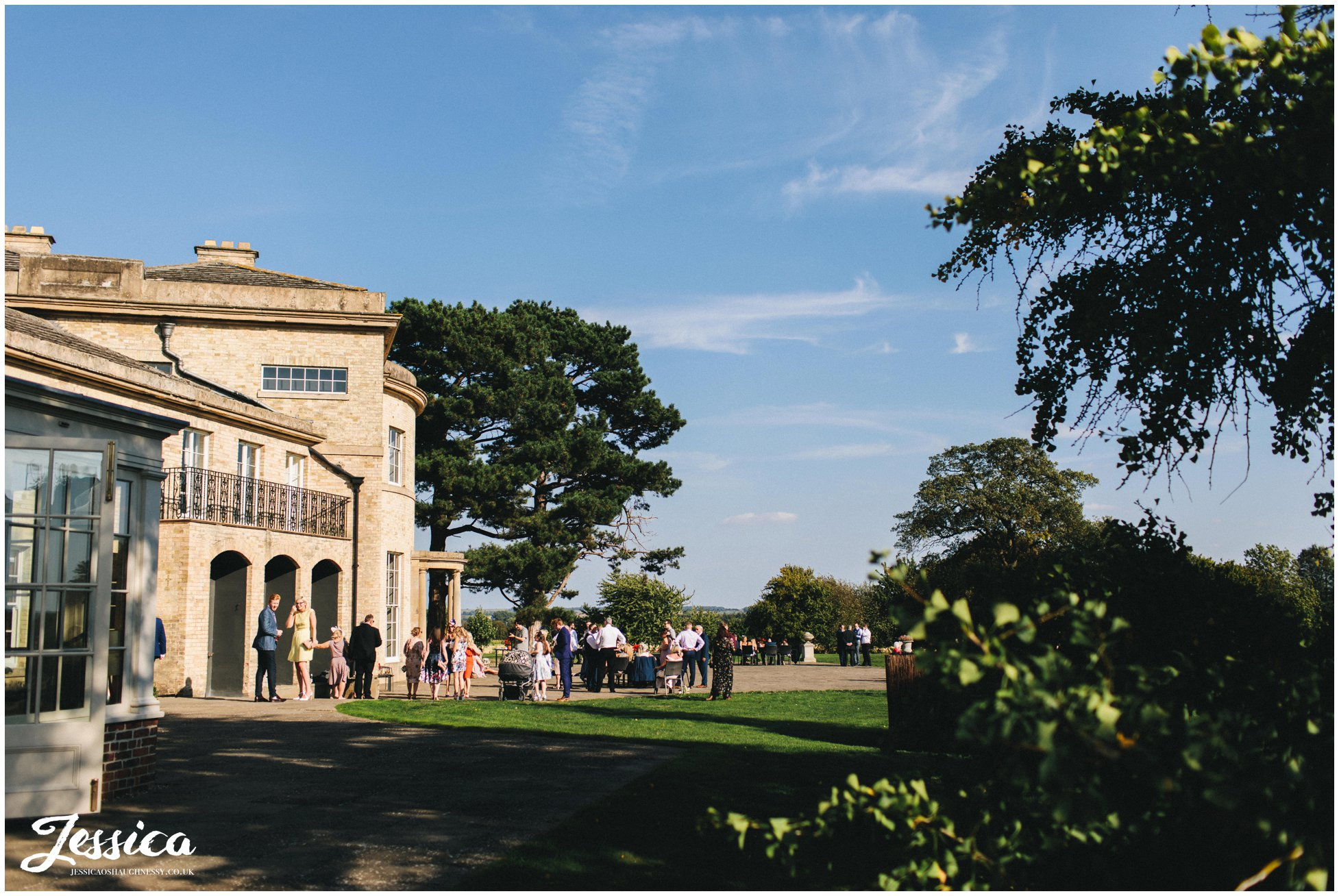 guests enjoy the weather at stubton hall champagne reception