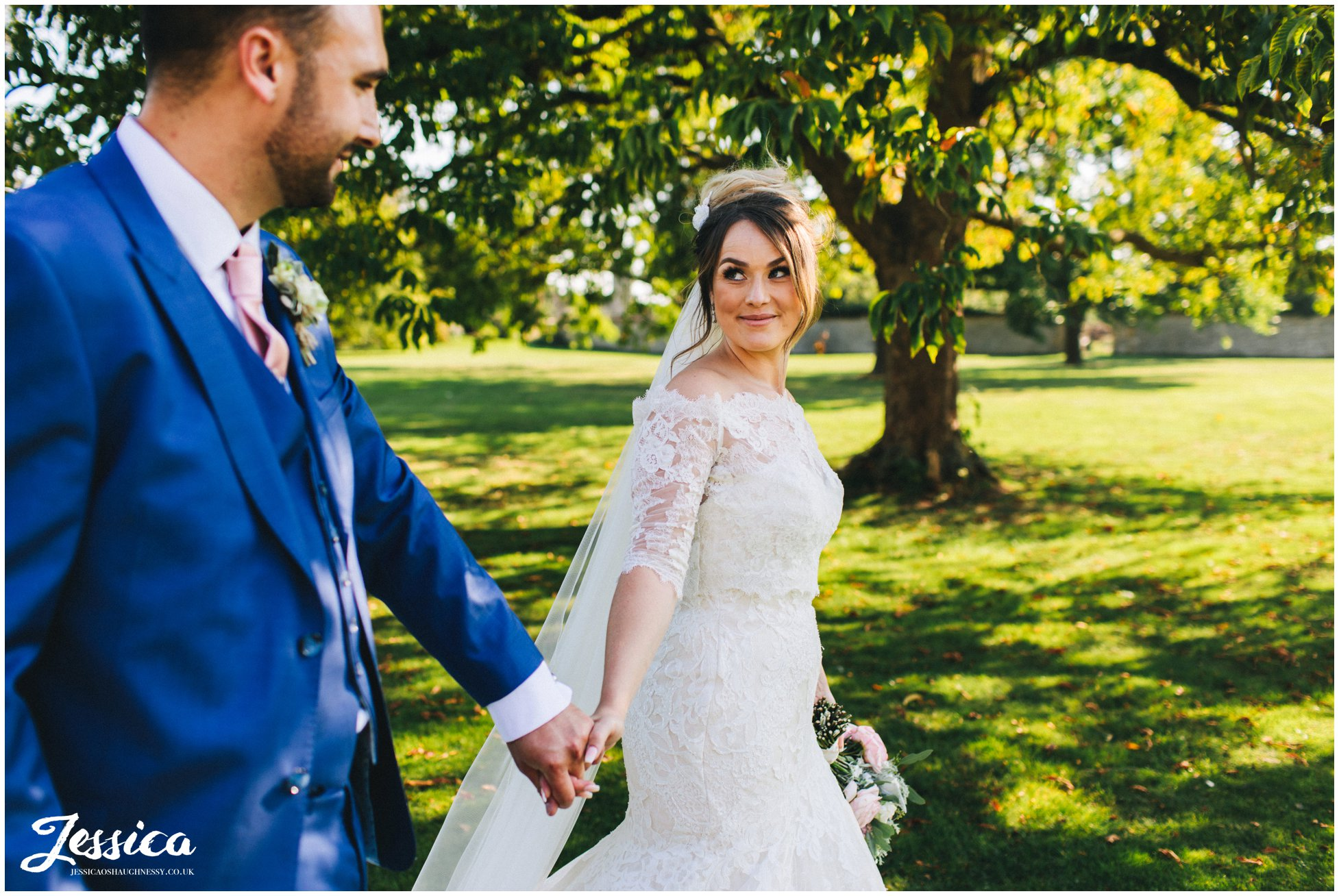 the couple walk through stubton hall's gardens