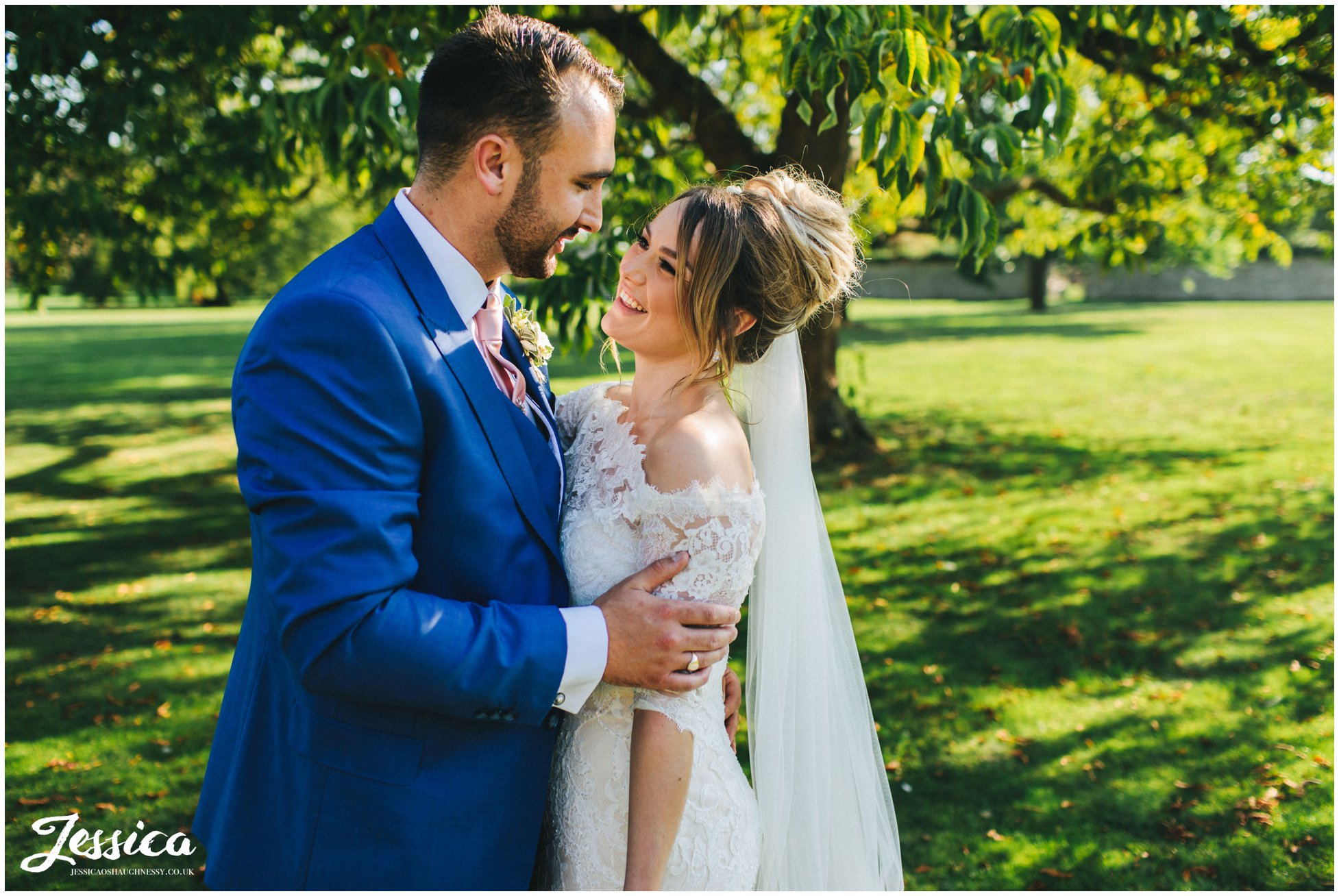 husband and wife laugh together in the venue's grounds