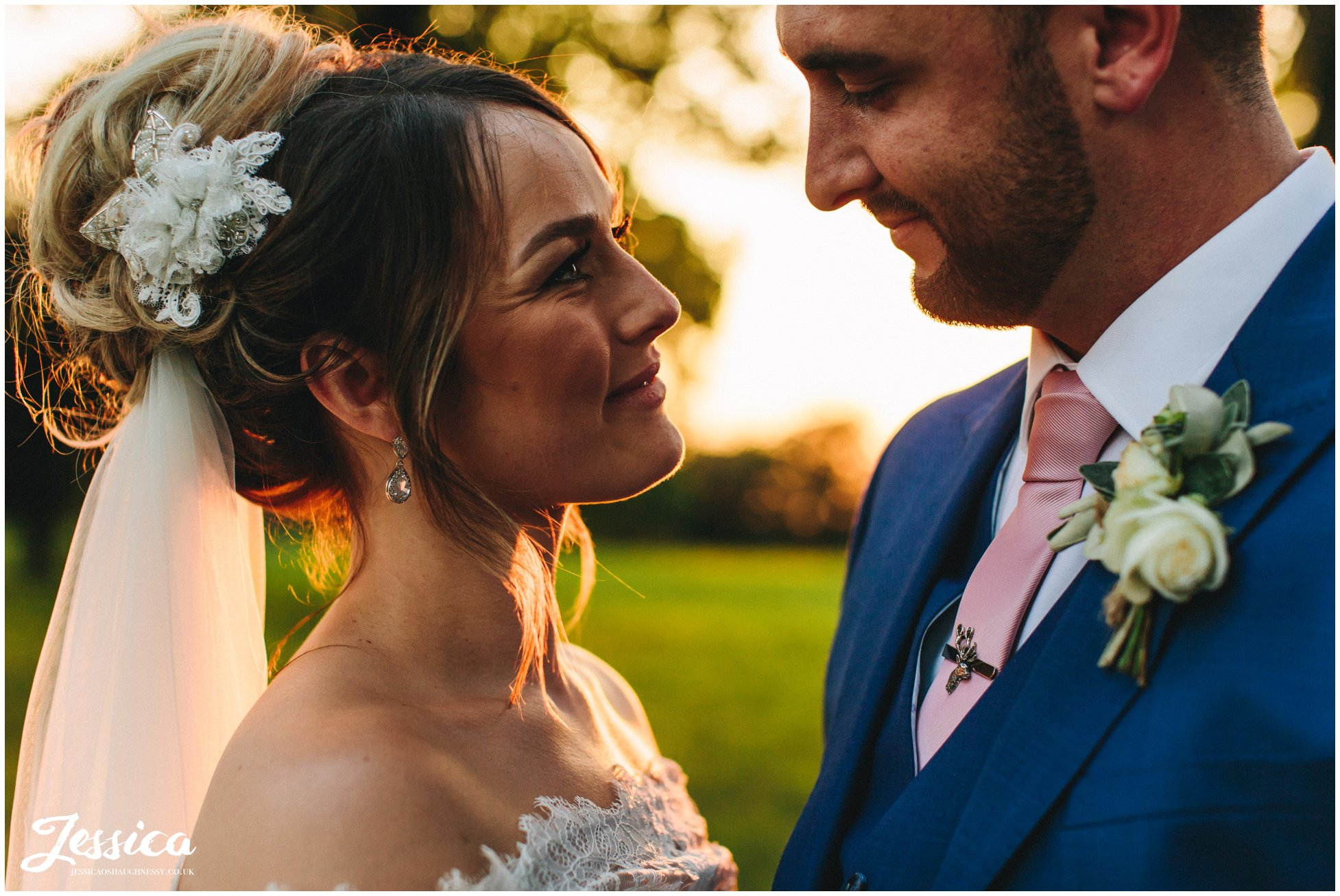 the bride smiles at her groom at stubton hall