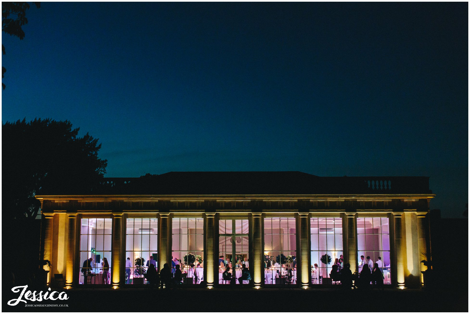 stubton hall lit up at night for the evening reception