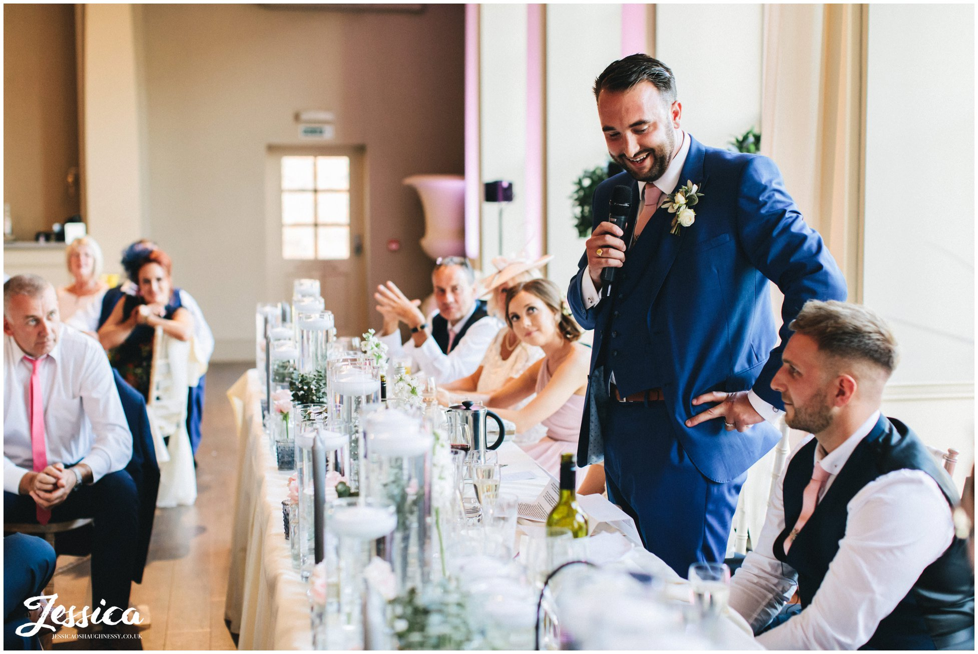 the groom delivers his speech at his newark wedding