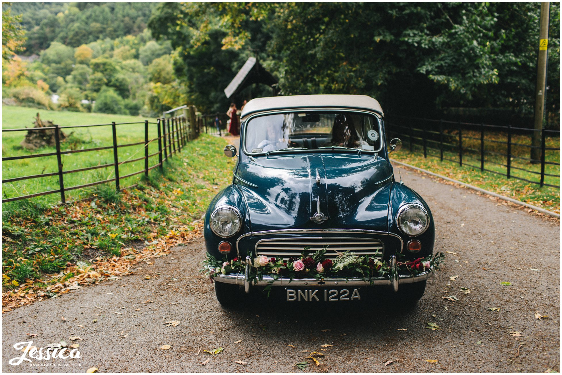 the bride arrives in a vintage car