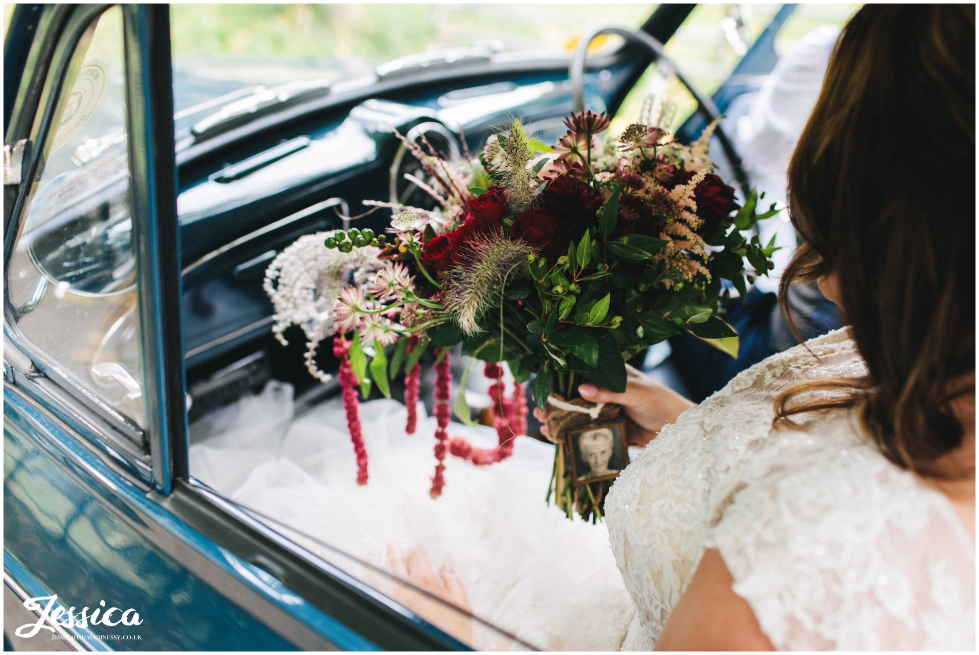 the bride holds her rustic bouquet