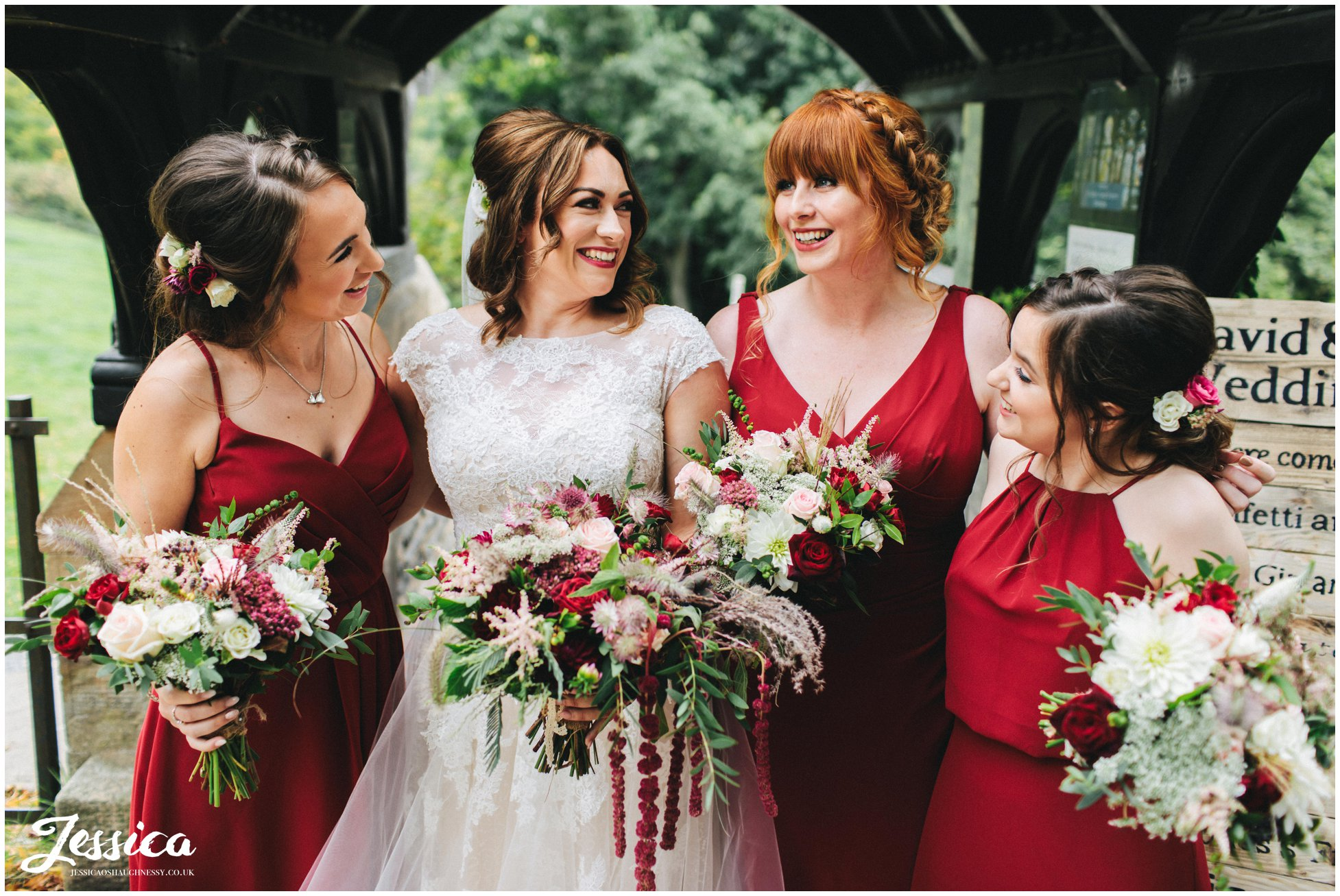 the bride laughs with her bridesmaids before the ceremony starts