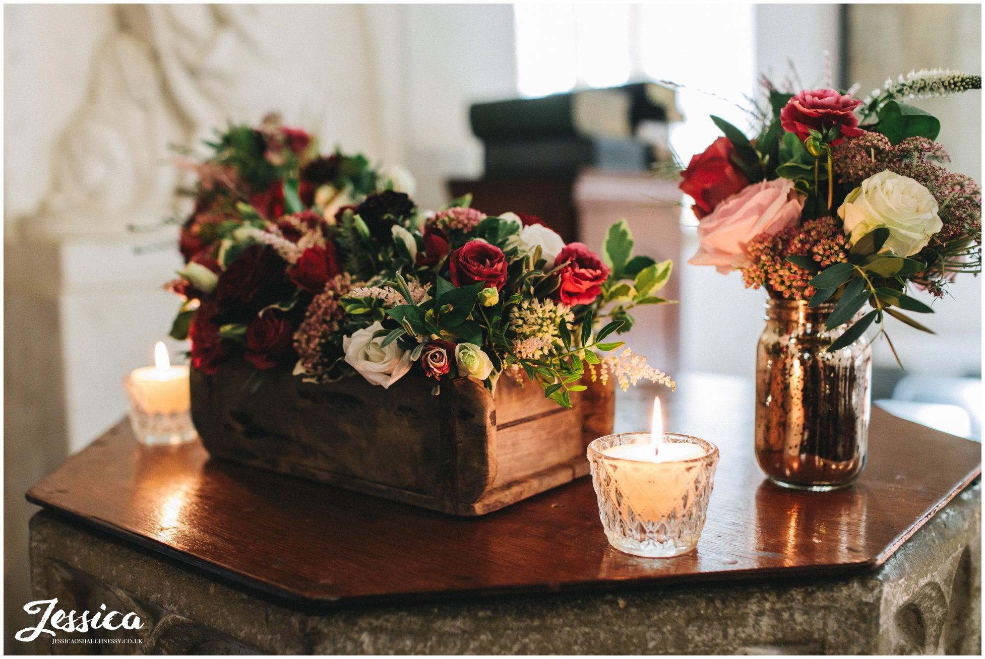 the church is decorated in rustic red flowers