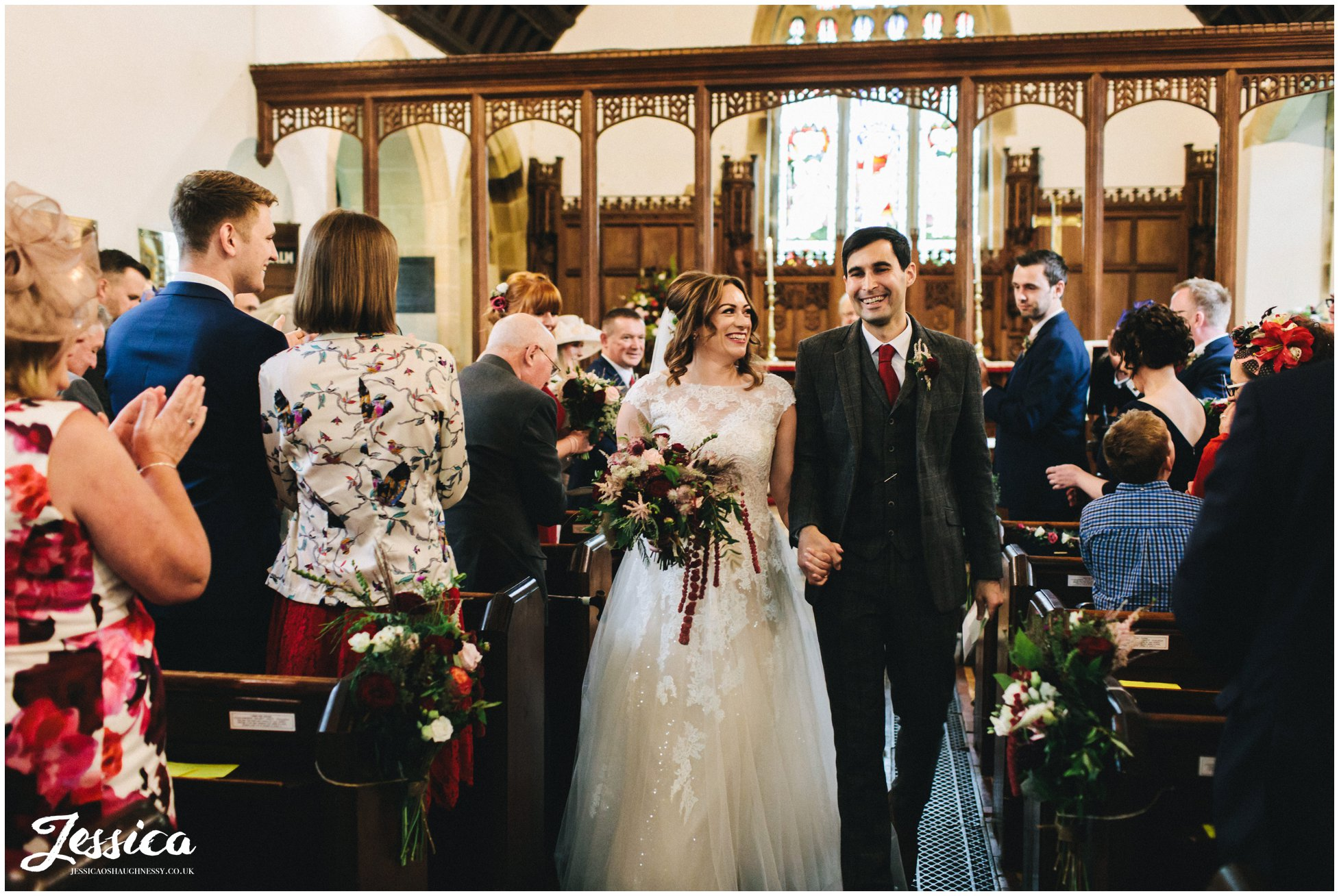 the newly wed's walk down the aisle as husband and wife