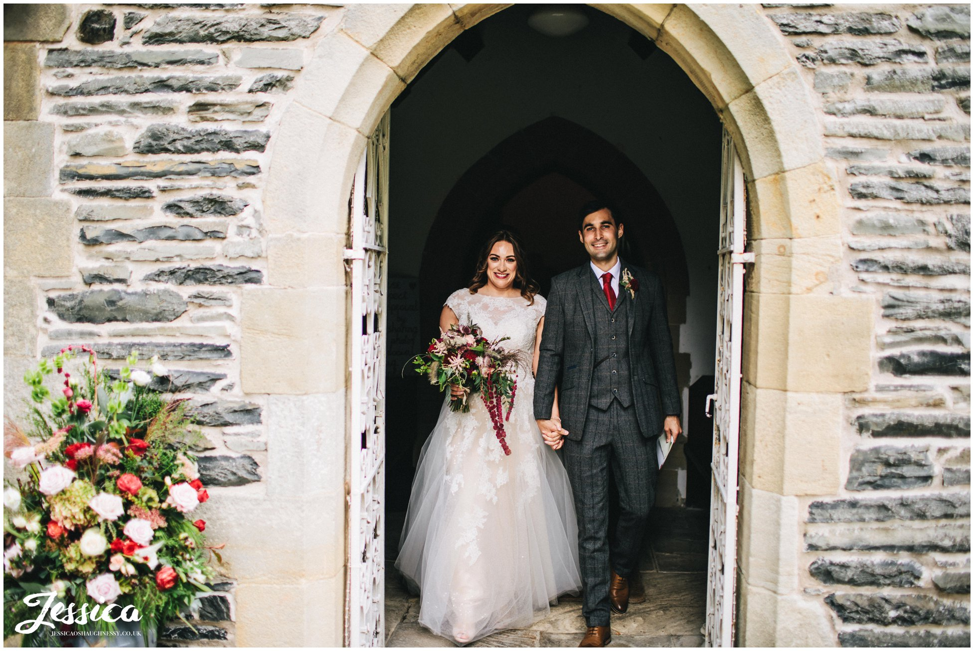 the couple exit Llantysilio church in north wales