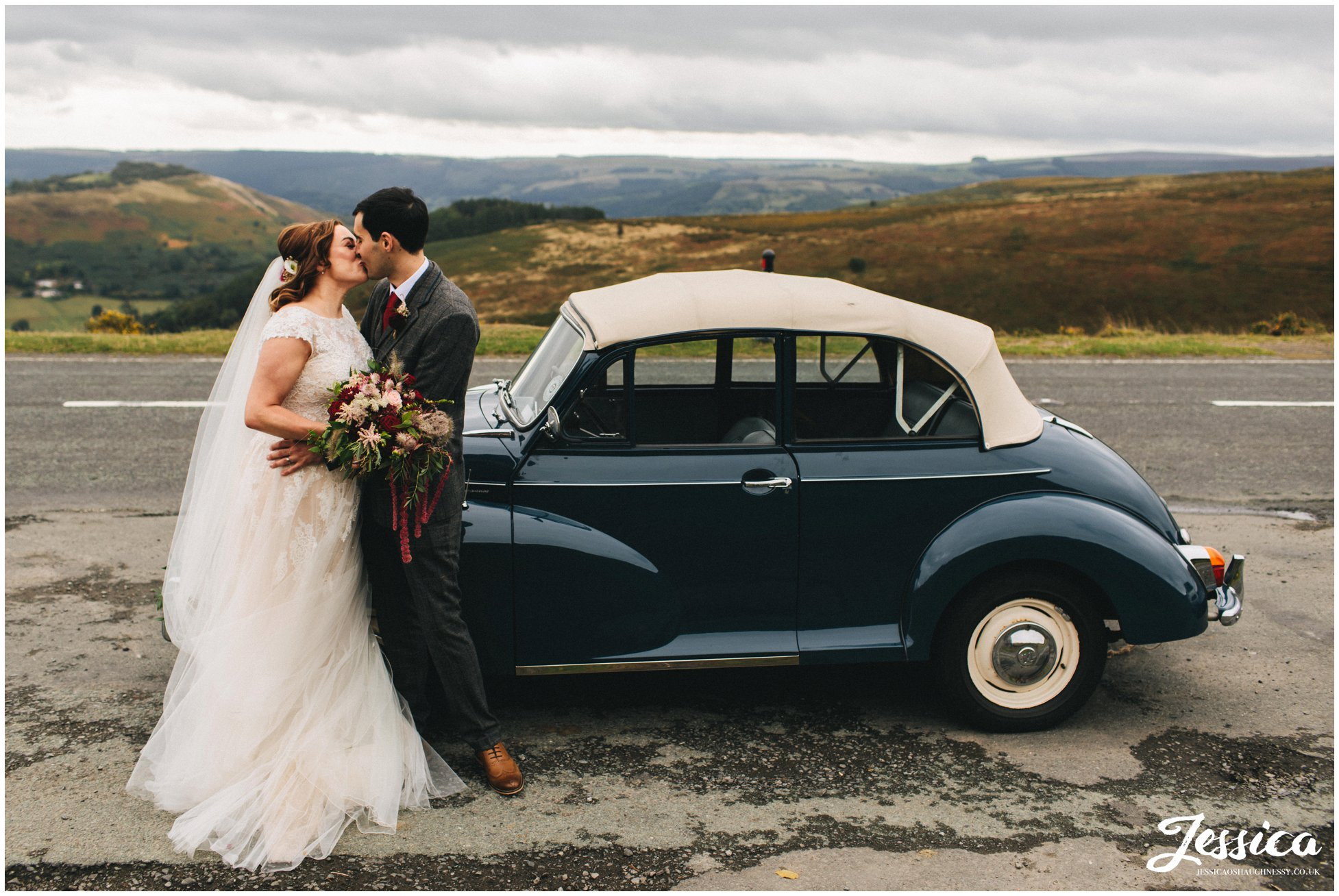the couple pull over in a lay by for photographs