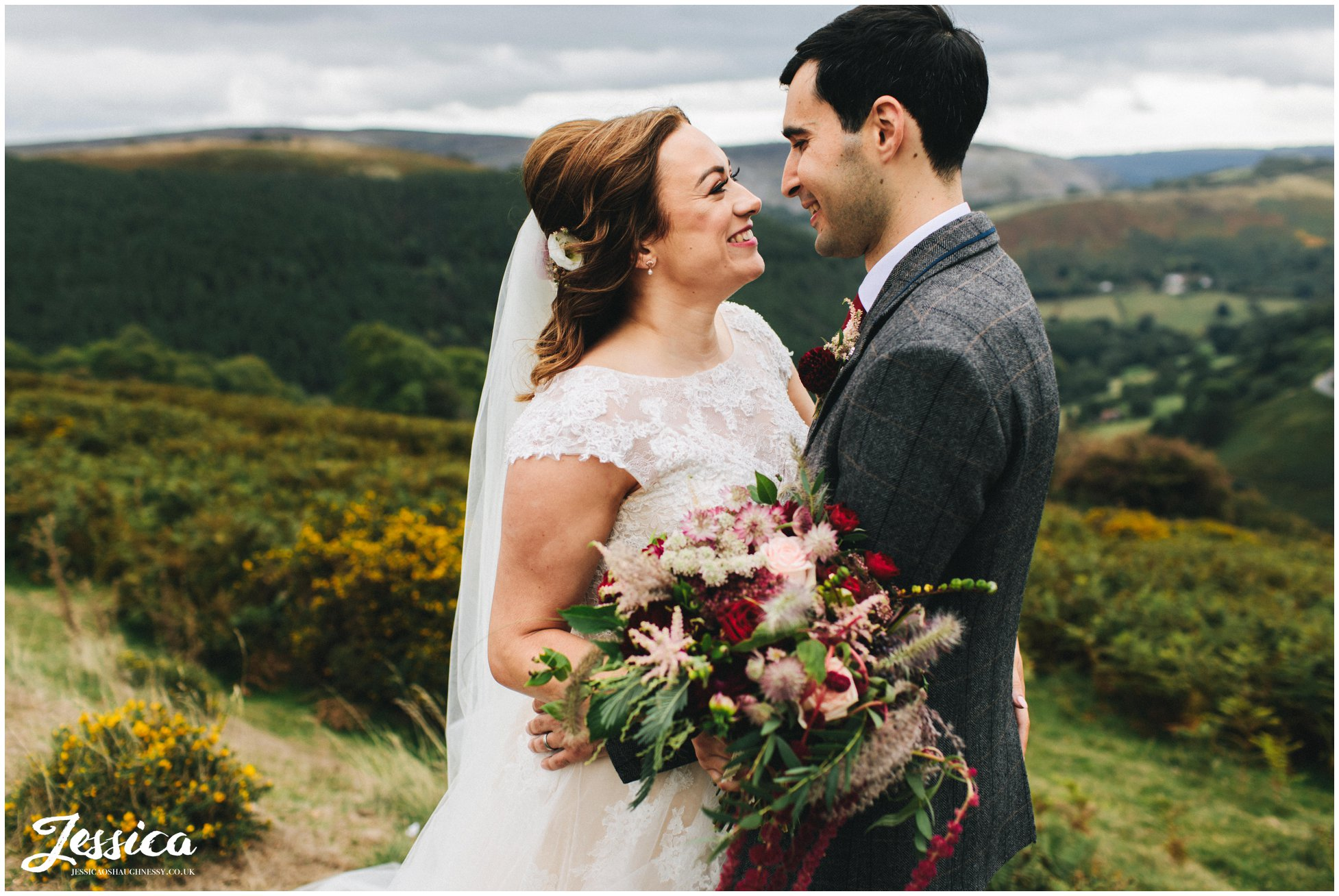 bride and groom have their photographs taken in picturesque north wales area