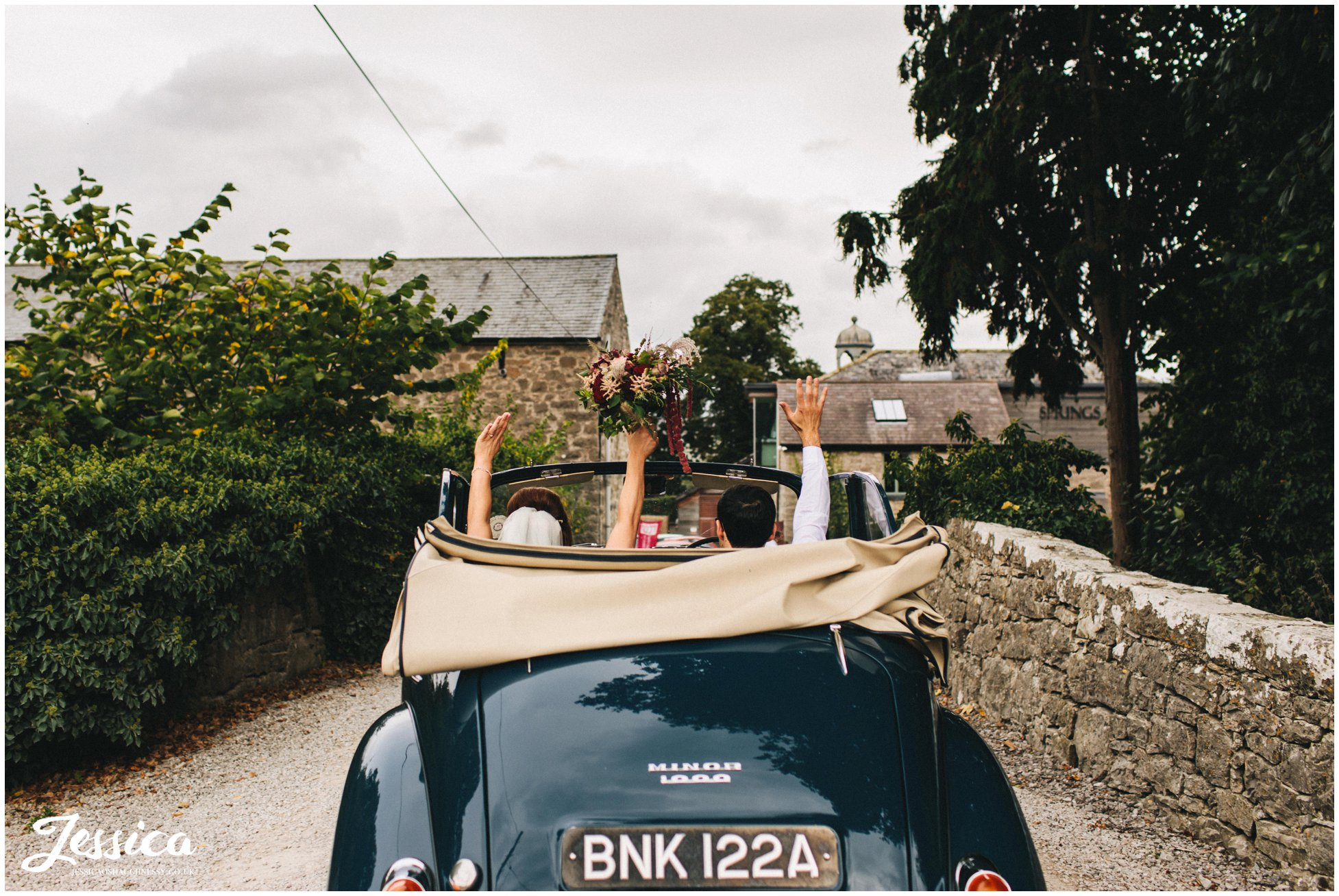 the couple cheer as they arrive at their north wales wedding venue