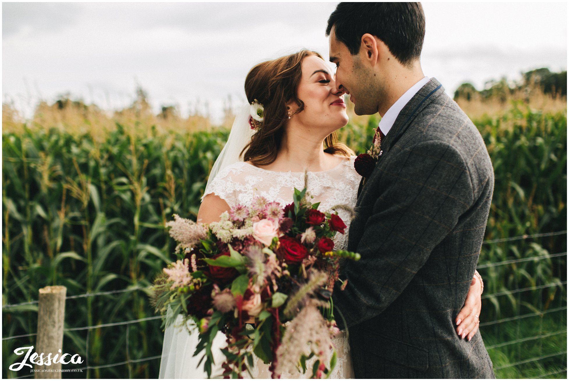 couple kiss infront of the cornfields