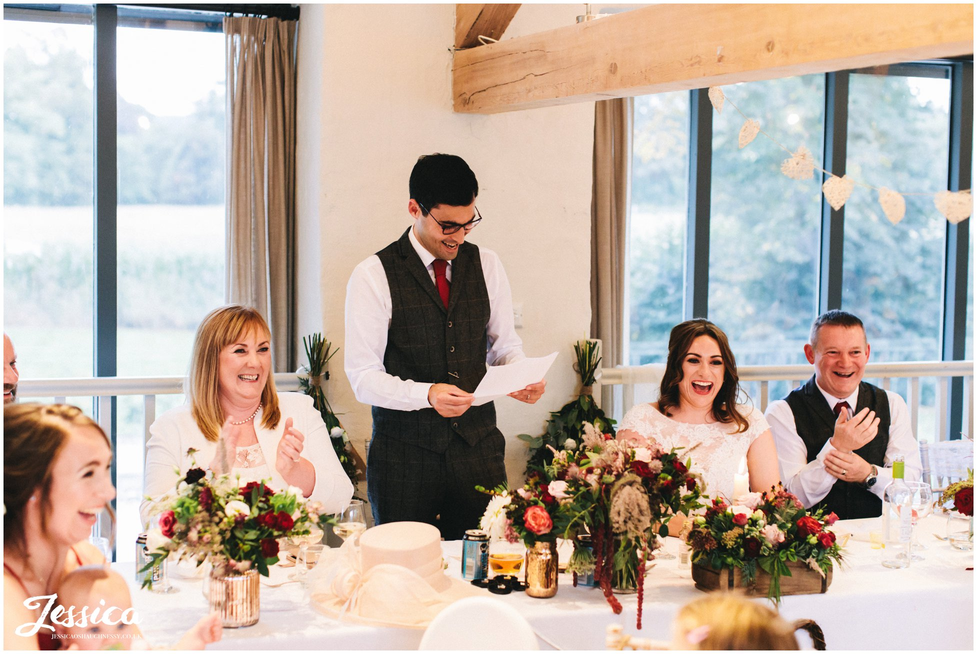 the groom stands to give his speech at Llanrhaeadr Springs