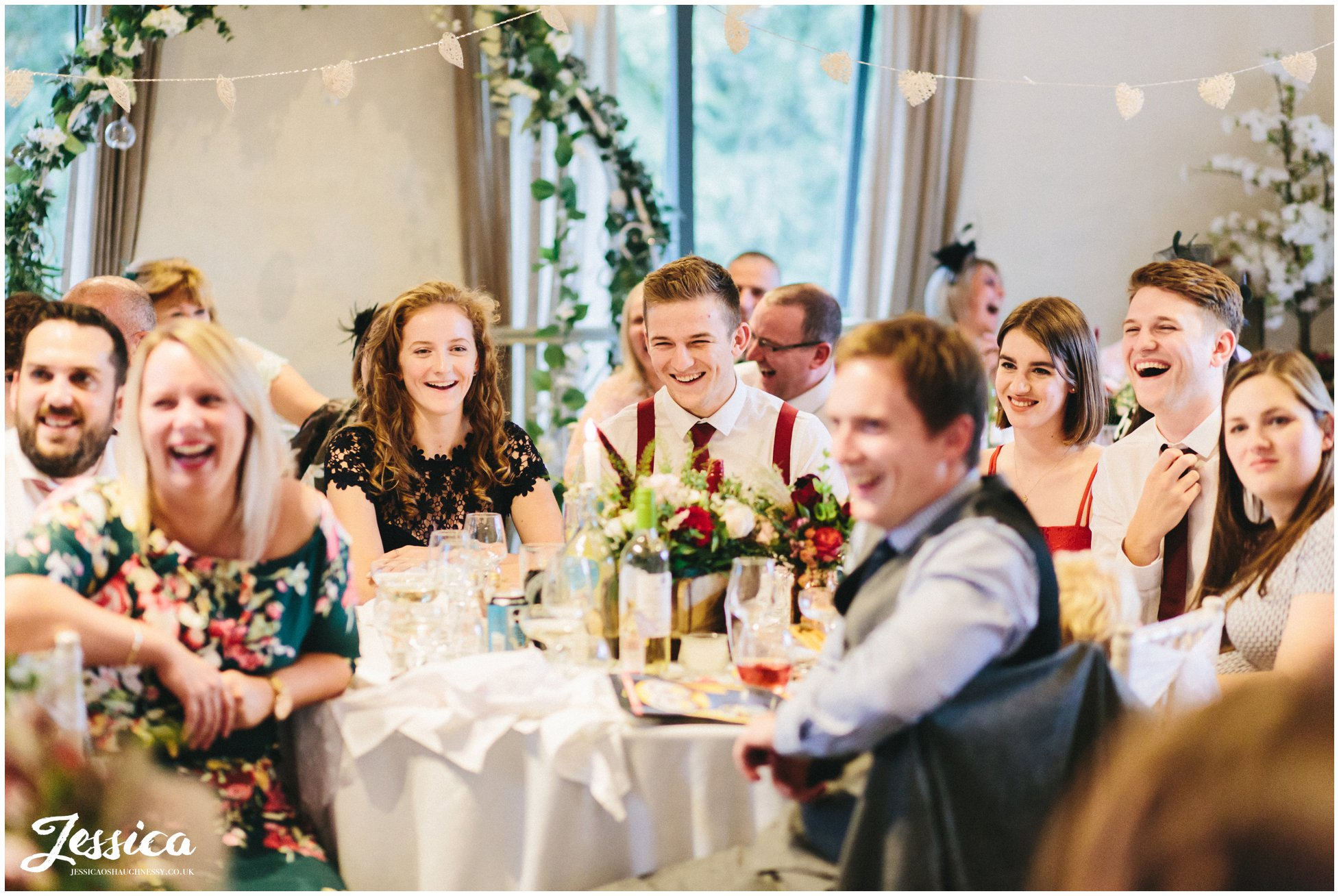 friends of the couple enjoy the funny speeches at Llanrhaeadr Springs in north wales