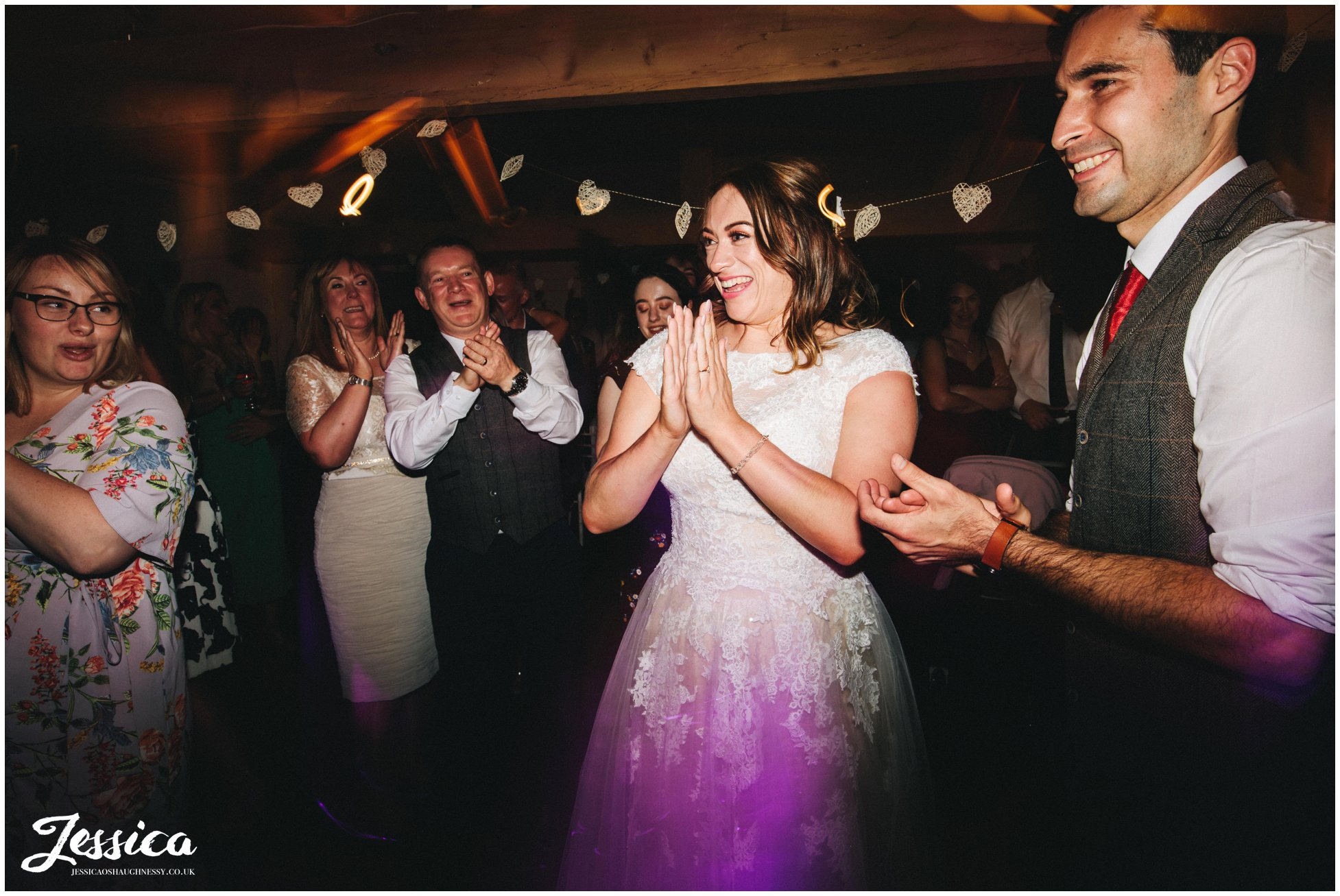the bride and groom applaud the band at Llanrhaeadr Springs in north wales