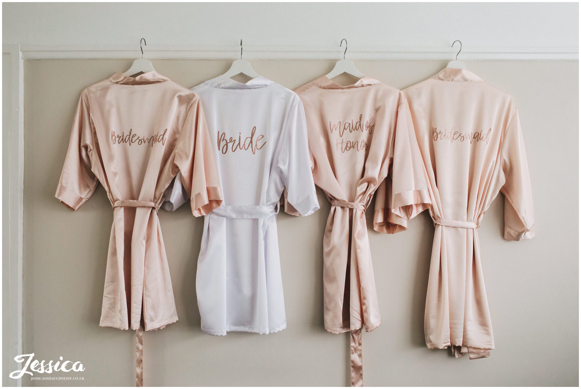 bridal party dressing gowns hanging up during bridal prep