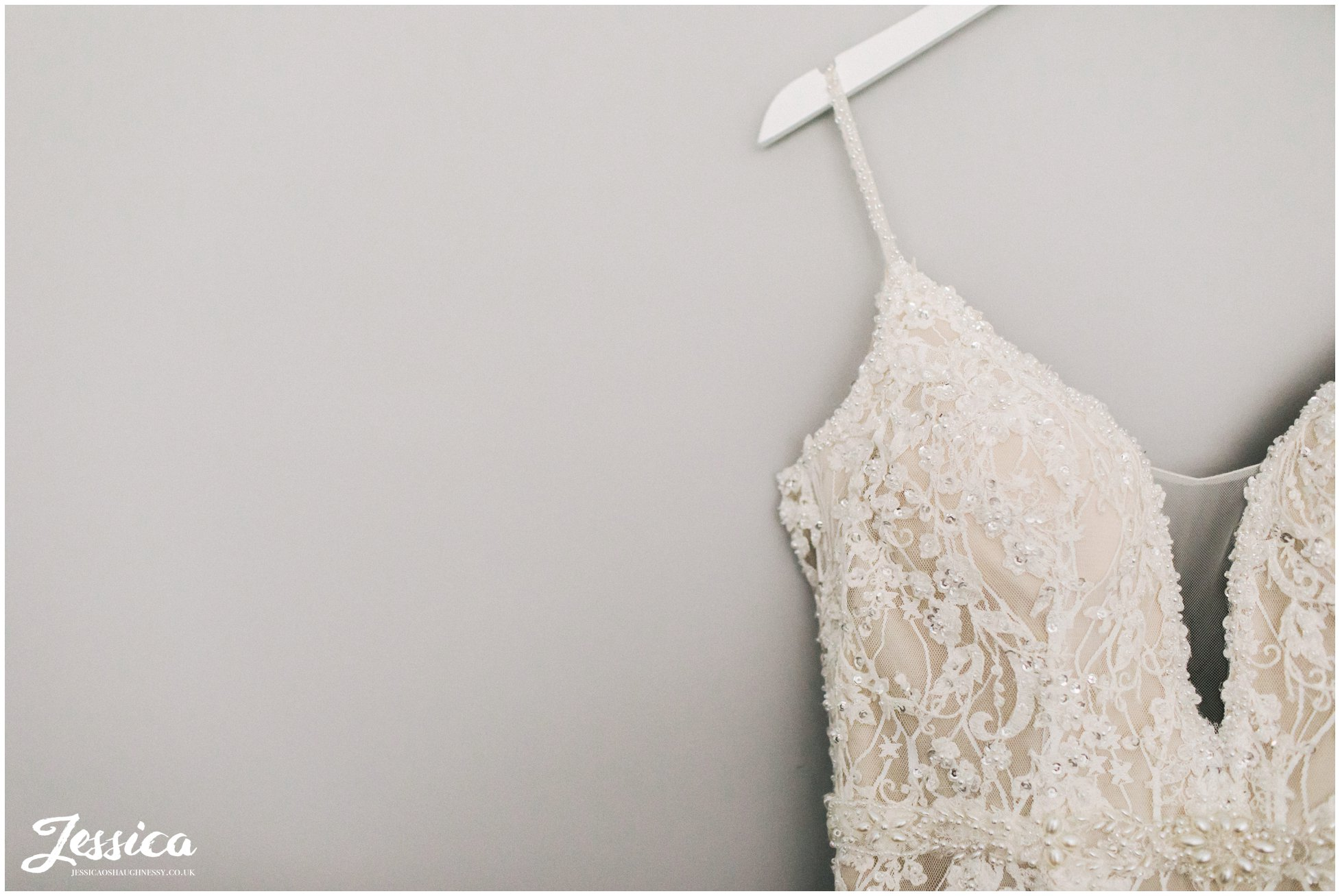wedding dress hangs ready for the bride