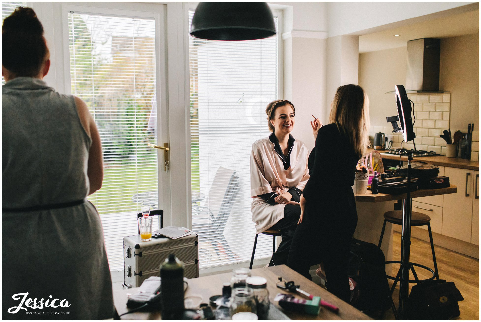 the maid of honour gets her makeup done