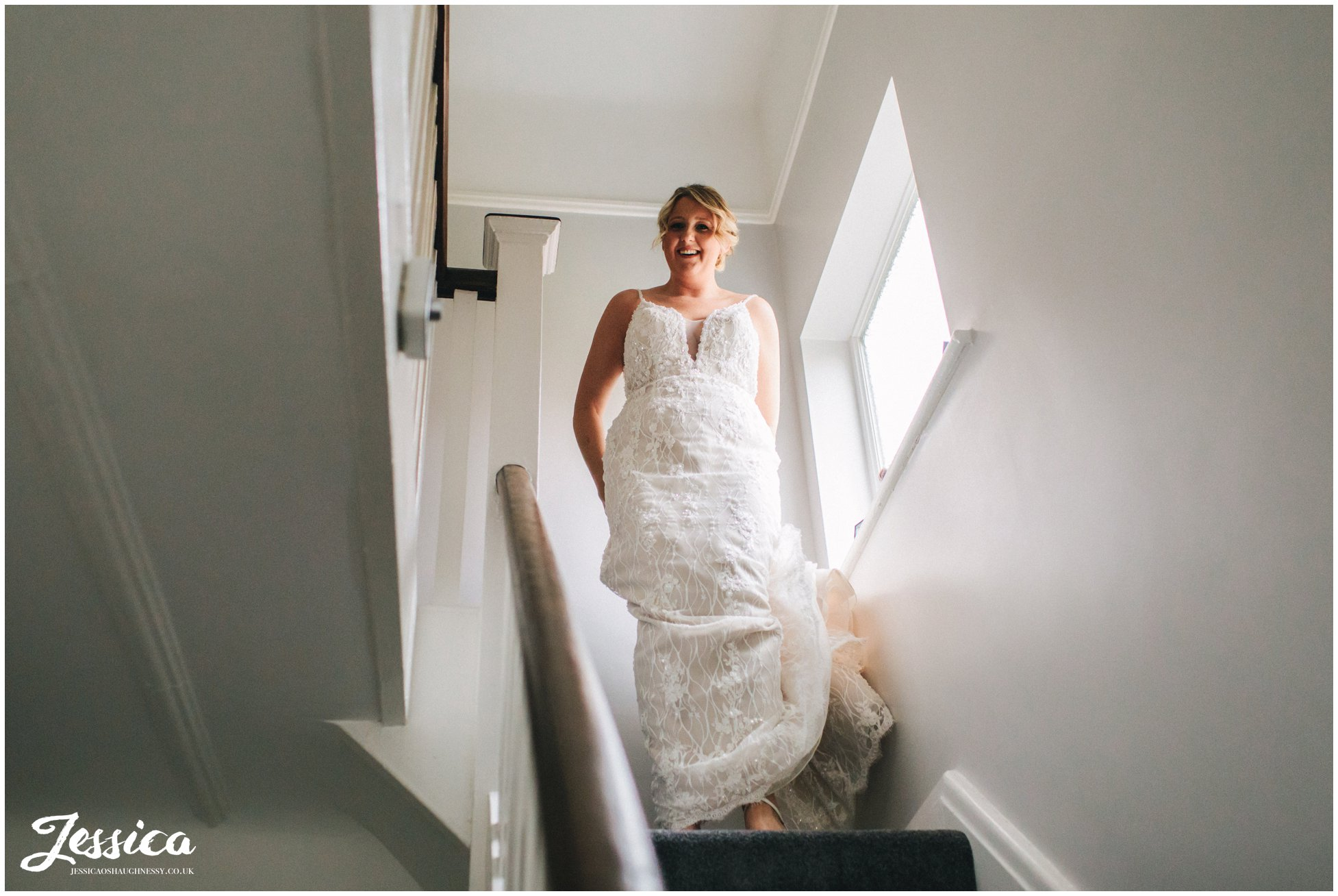 the bride comes downstairs dressed and ready to go