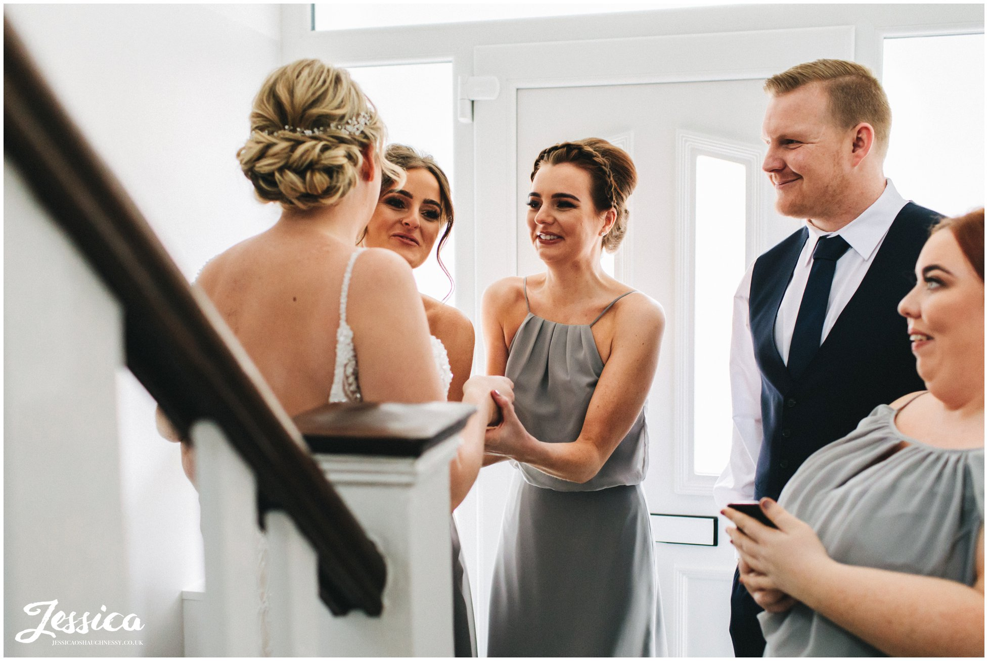 the bridal party get emotional seeing the bride in her dress