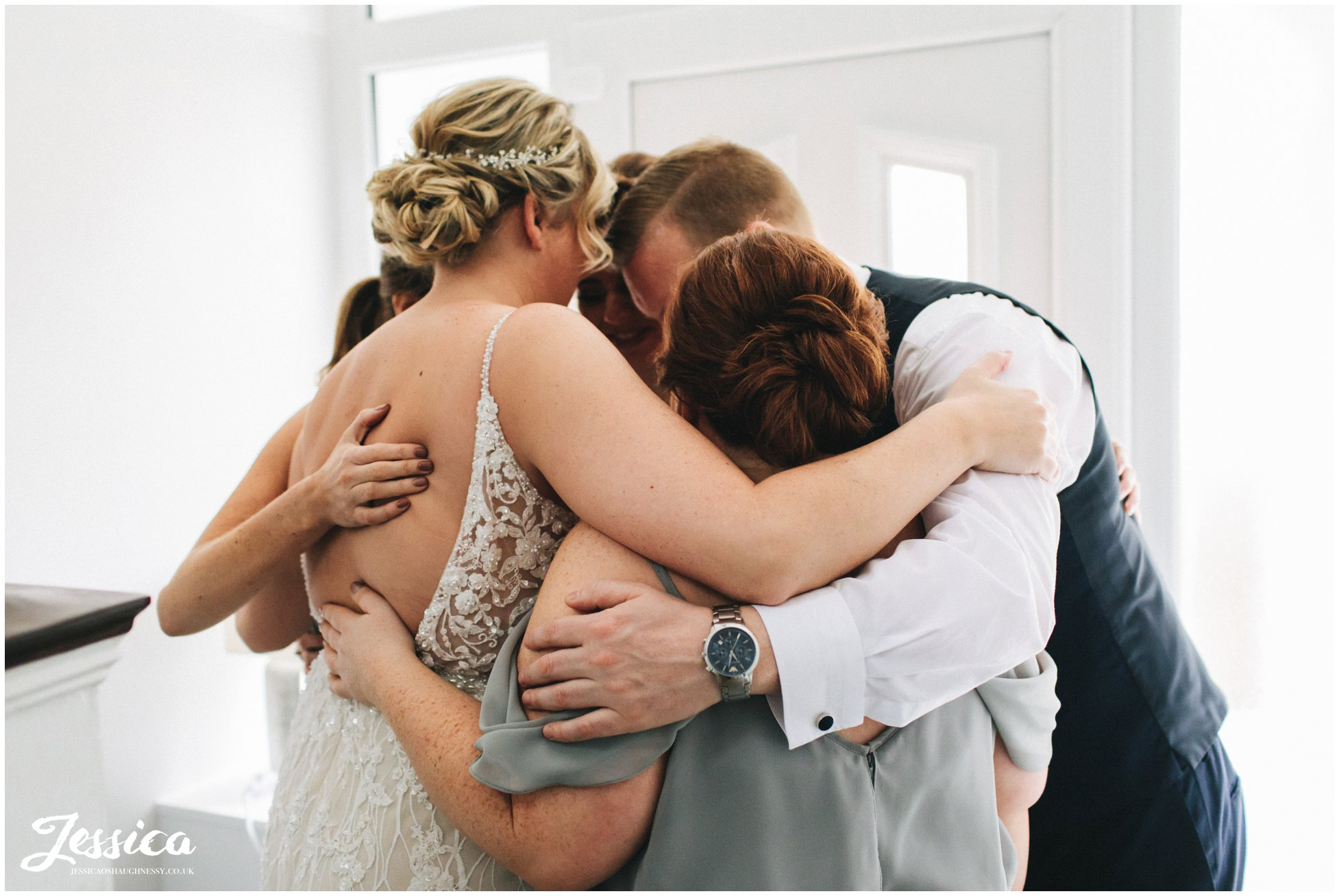 group hugs before the liverpool wedding ceremony