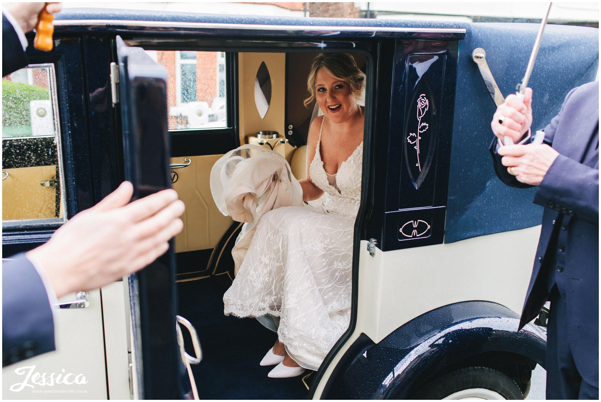 the bride smiles as she arrives at the liverpool church