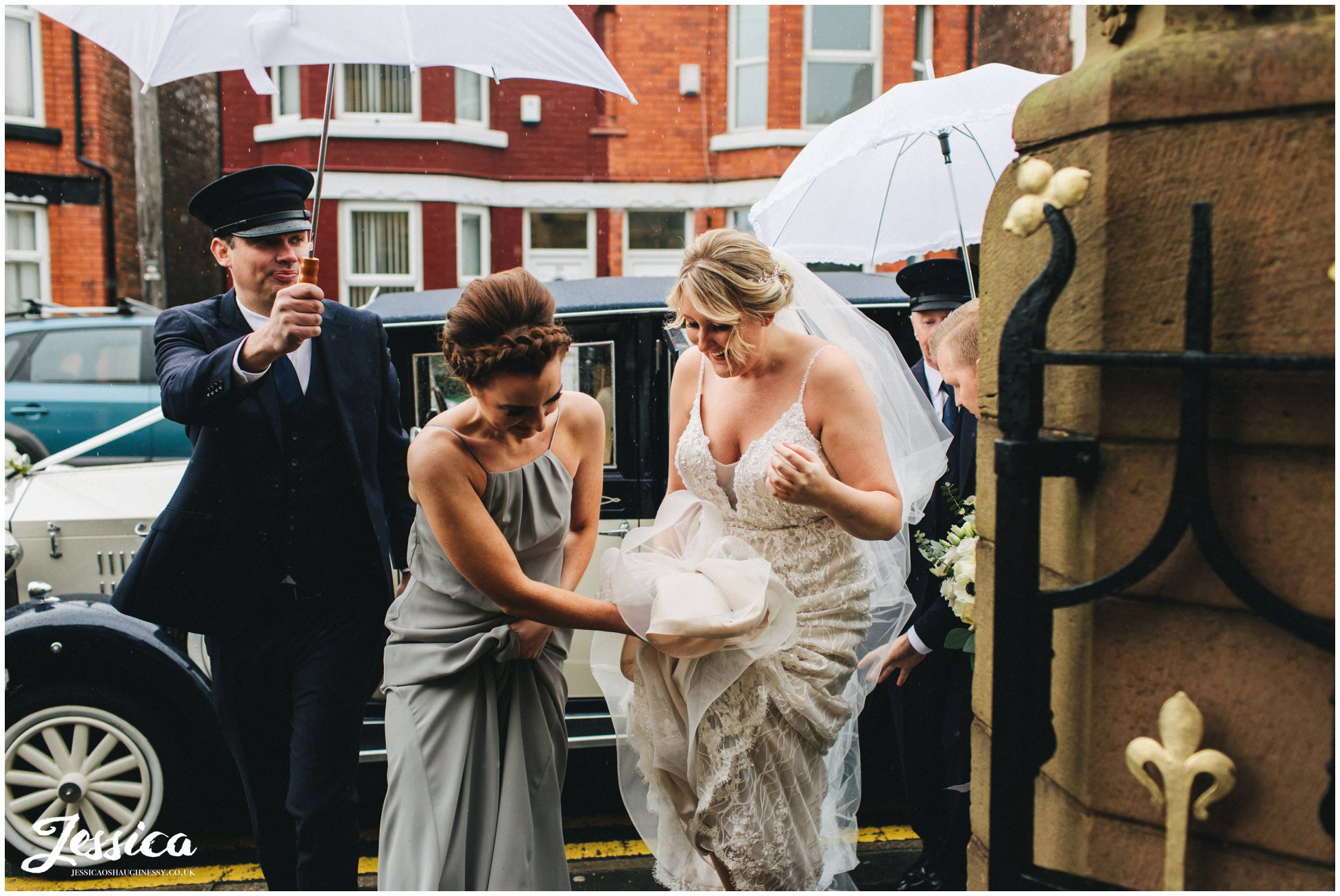everyone helps the bride stay dry and she enters the church