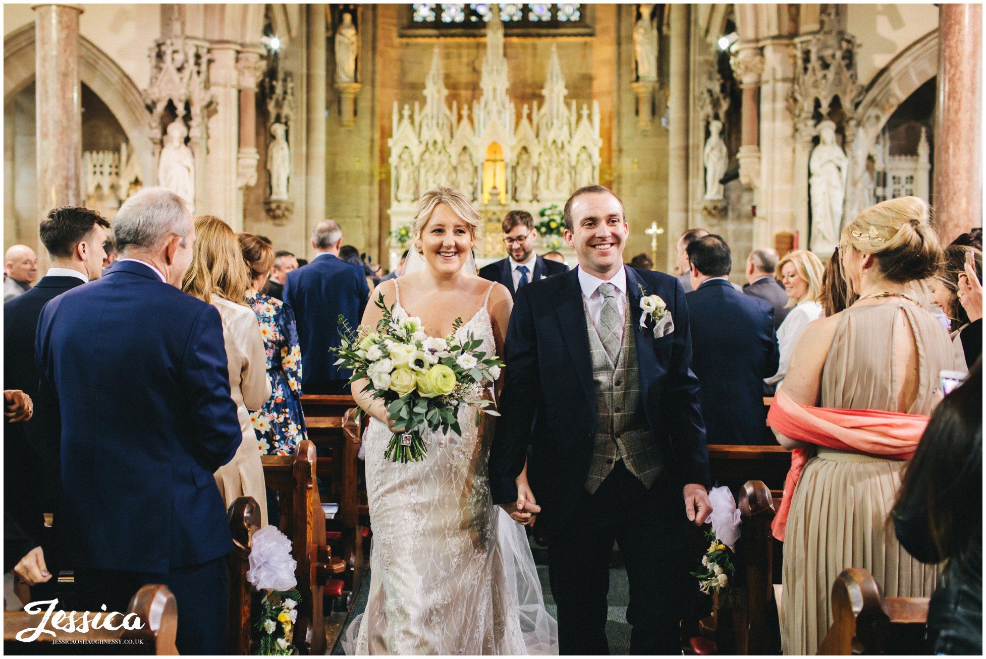 the newly wed's exit the church