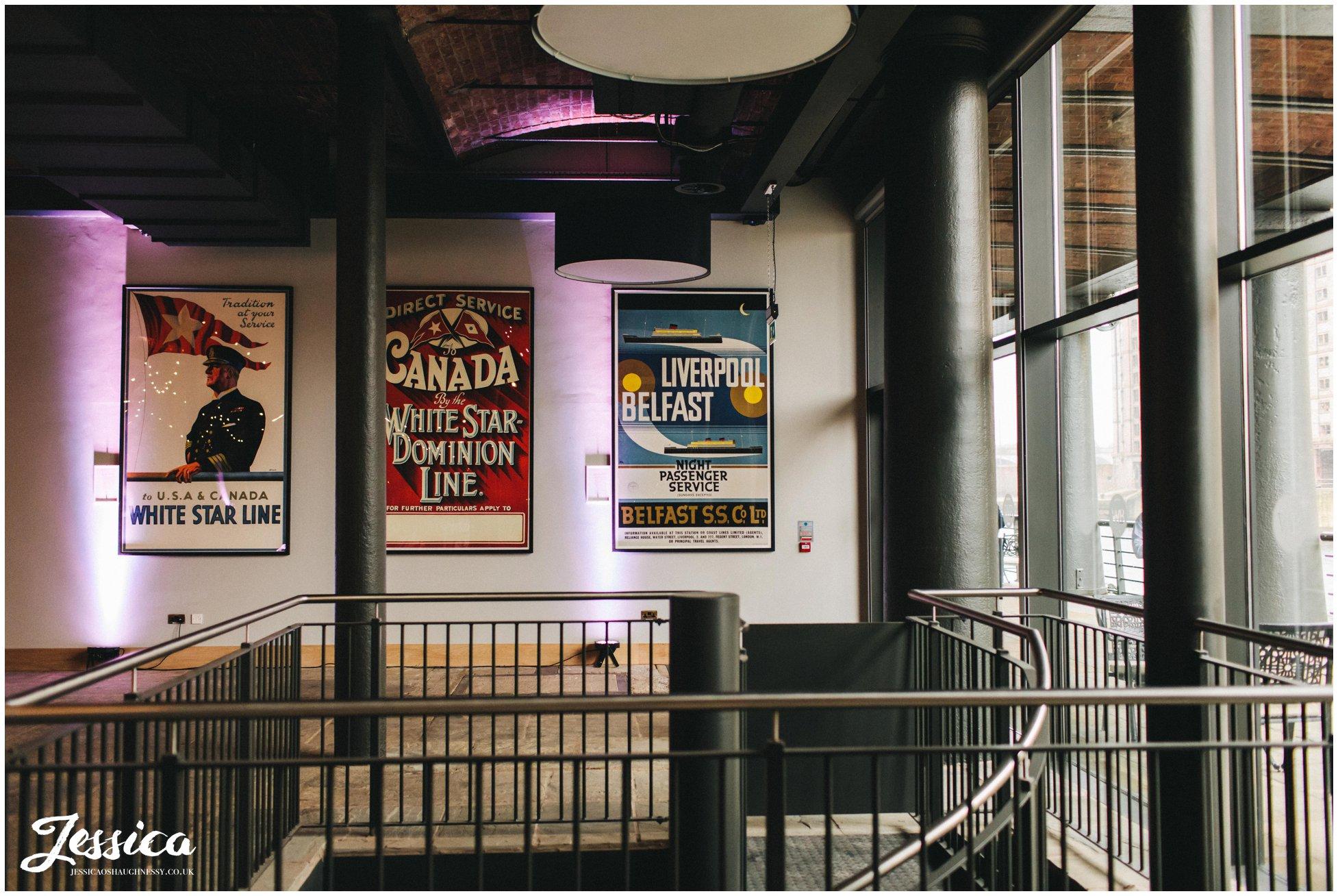 vintage titanic posters decorate the liverpool wedding venue